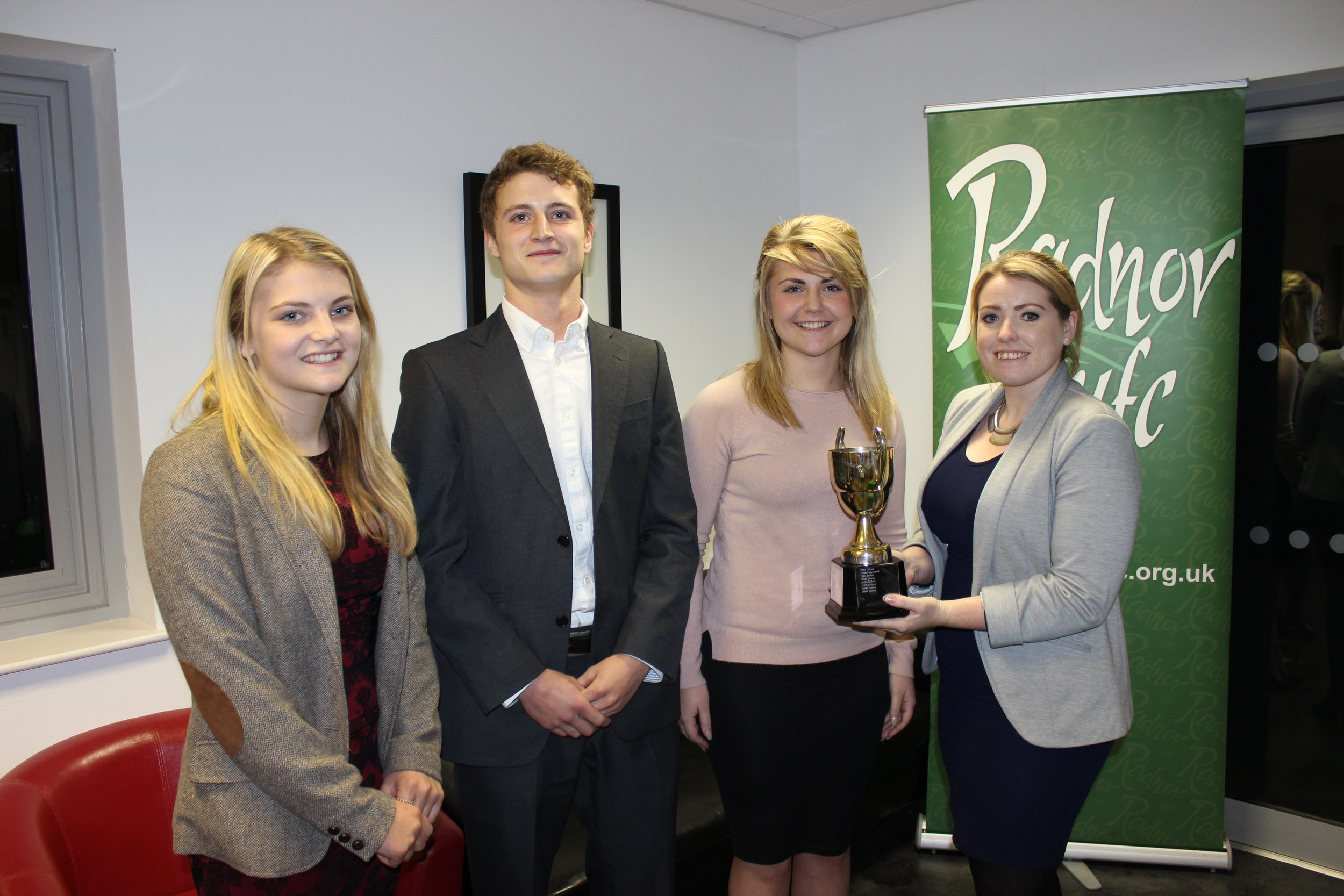 Llanbadarn Fynydd YFC being awarded the Overall Public Speaking trophy by County Chairman Heidi Davies.