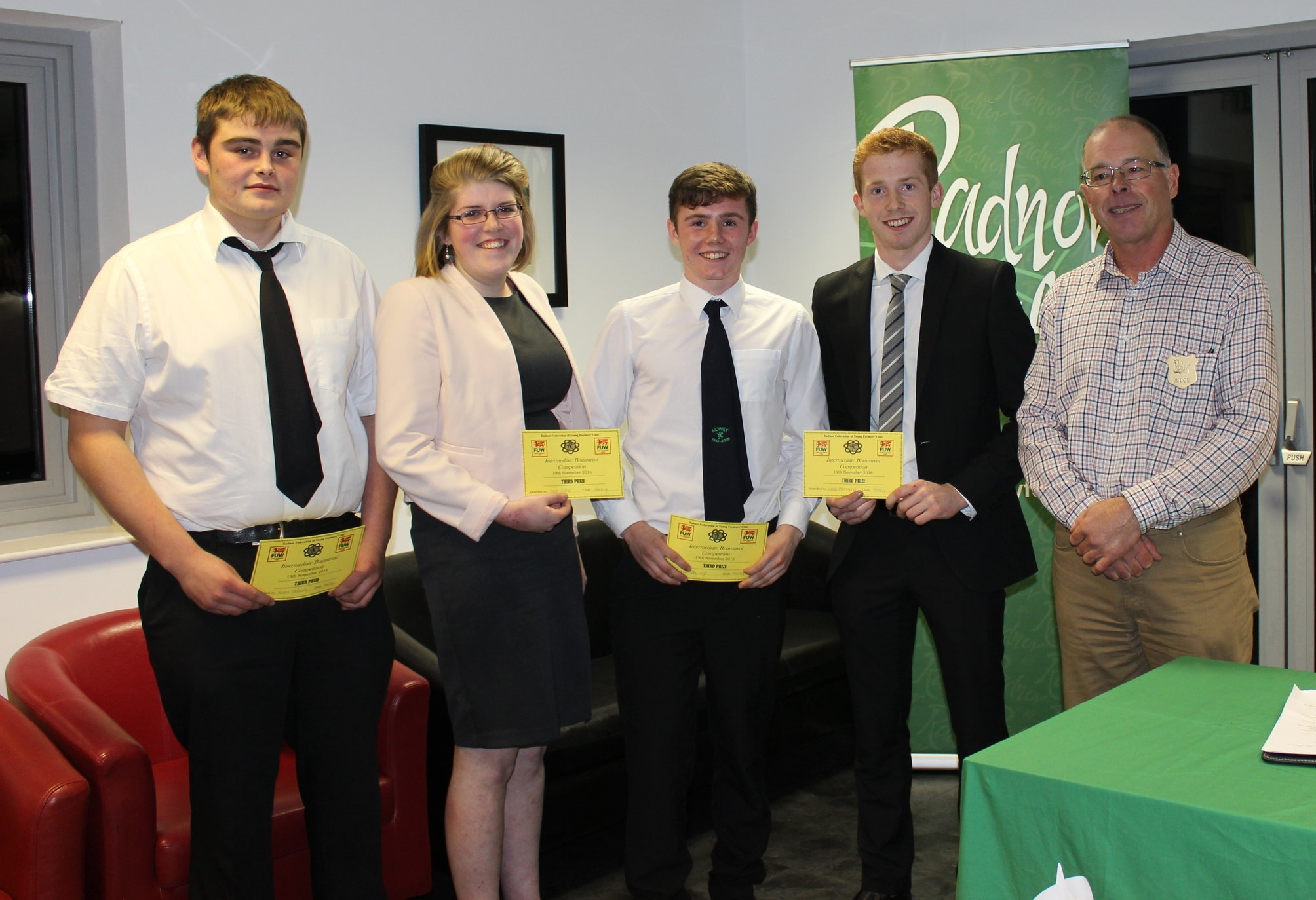 3rd Place Intermediate Brainstrust Ieuan Griffiths, Clare James, Toby Lloyd & Lloyd Hammond, Howey YFC with Judge Mr Ifor Humpreys.