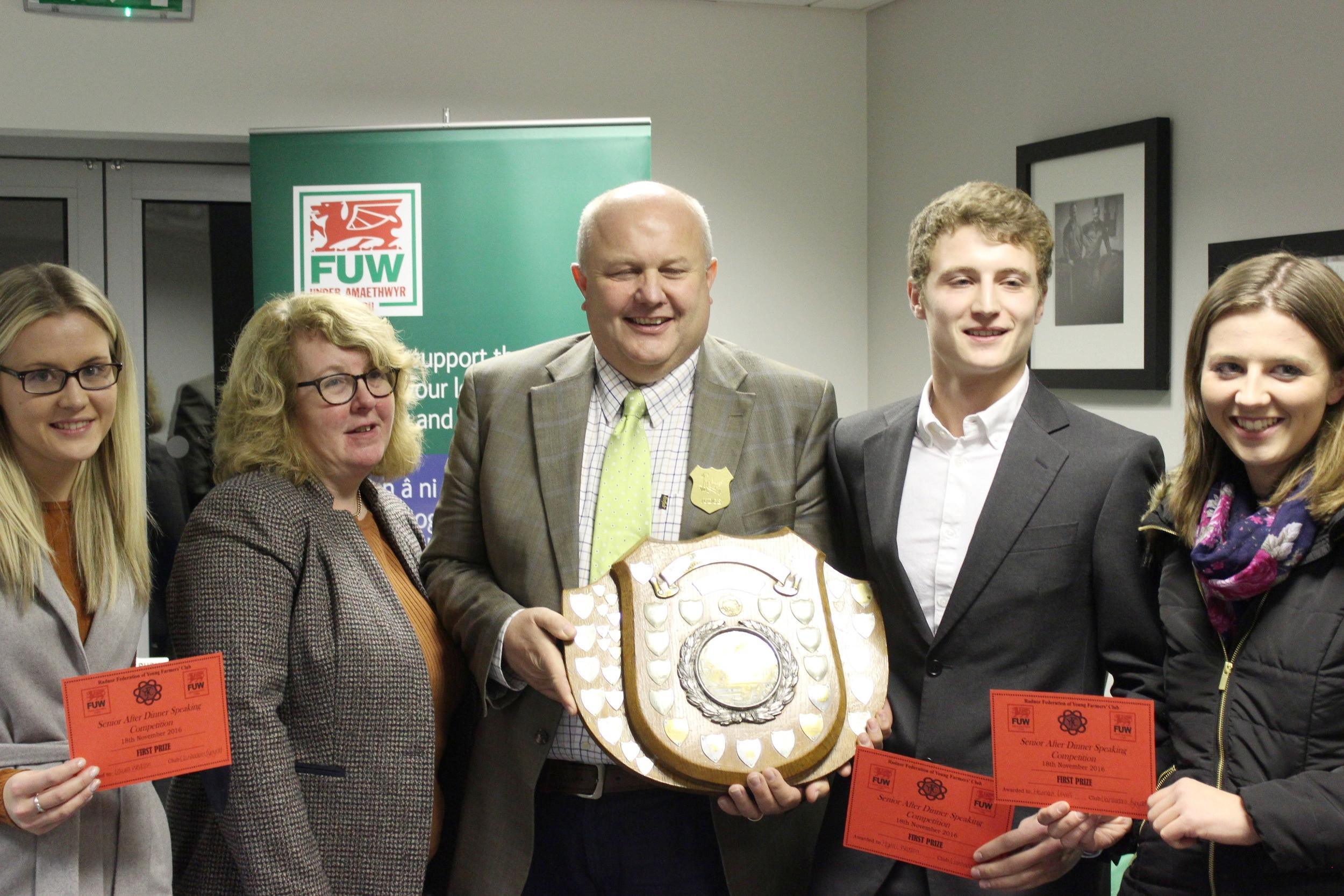 Winners of the Senior After Dinner Speaking Laura Watson, Hywel Watson & Hannah Lewis Llanbadarn Fynydd YFC with judges Stuart & Karen Anthony.