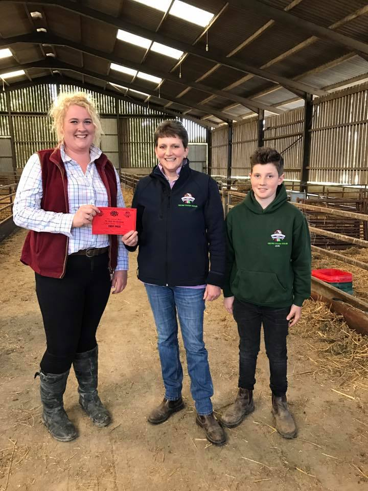 Floss Lewis accepting first prize on behalf of Hywel Rees, Cantal YFC Under 16
