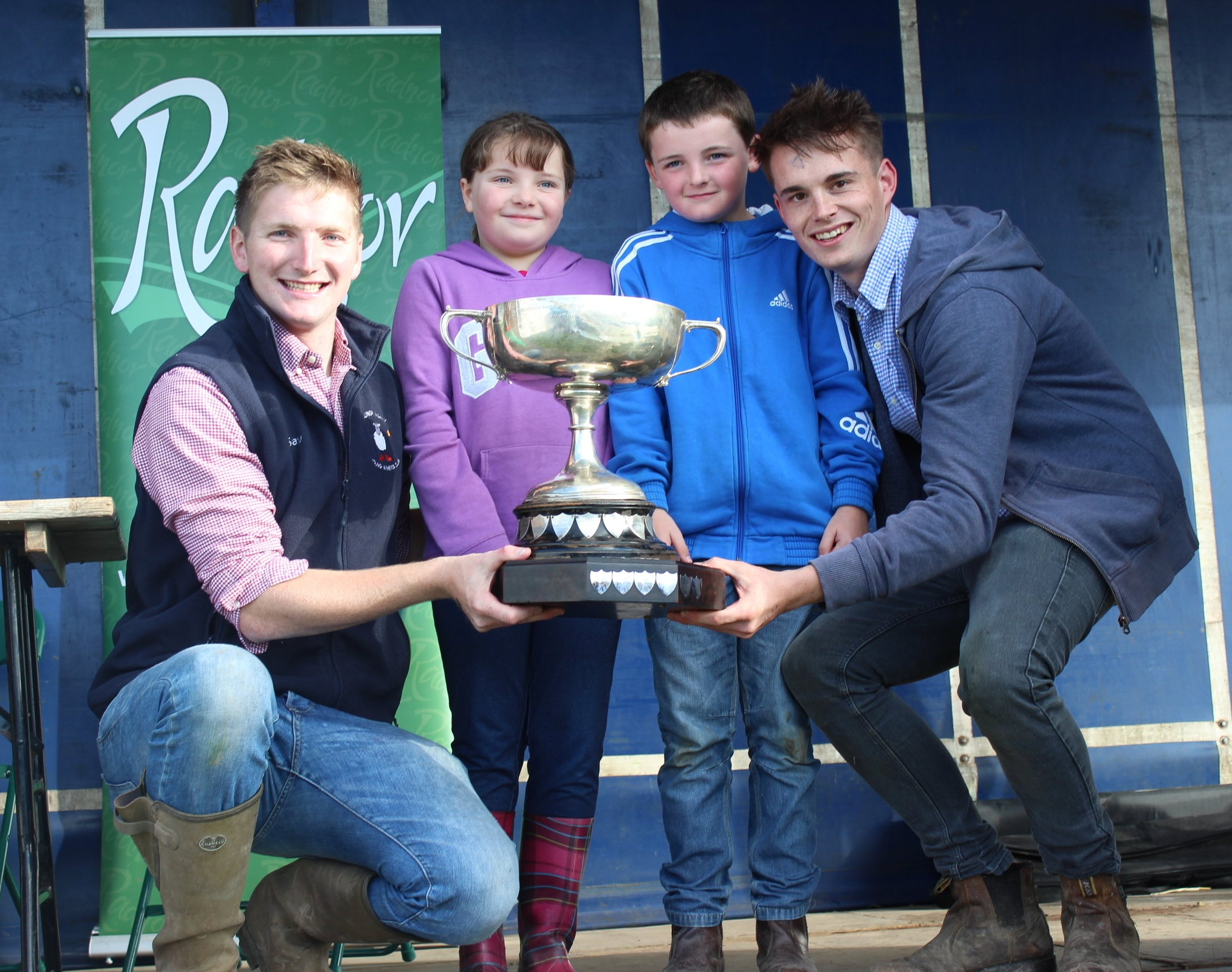 Robbie Savage & Ed Hamer, Radnor Valley YFC being presented with the Major HEB Holden Perpetual Challenge Cup by our Sponsors for the day Lizzy & Johnny Hughes of JHS.