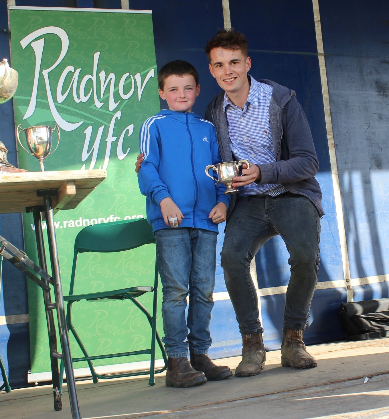 Johnny Hughes of JHS presenting Ed Hamer, Radnor Valley YFC with the Hector Morris Challenge Cup for the highest mark in the Home/Craft Section.