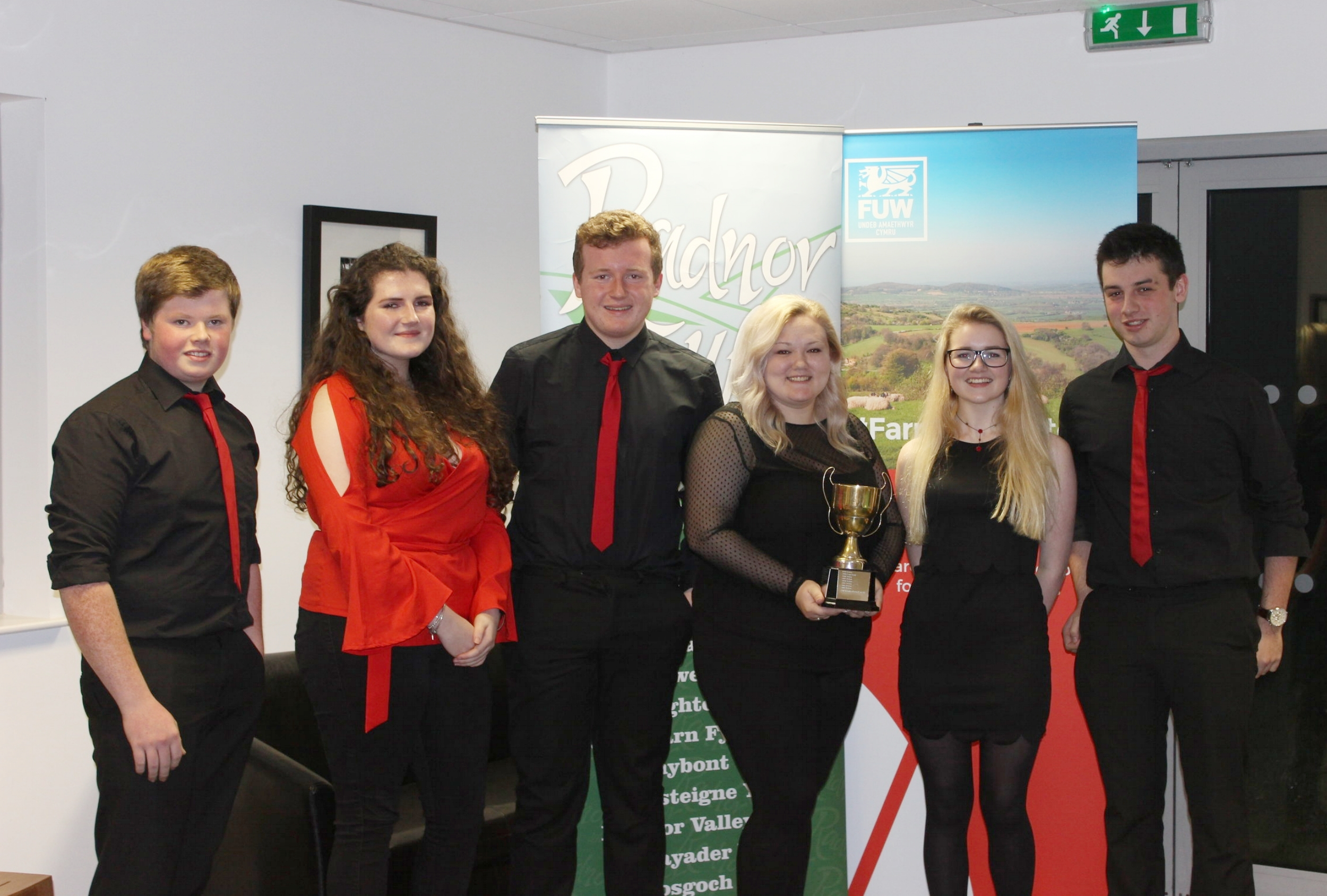 Mark Nixon, Lucinda Mitchell, Teddy Mitchell, Rebecca Williams, Eli Hulin Taylor & Will Davies, Edw Valley YFC with the B Evans Cup for the highest marks after the Junior, Intermediate and Senior Public Speaking competitions.
