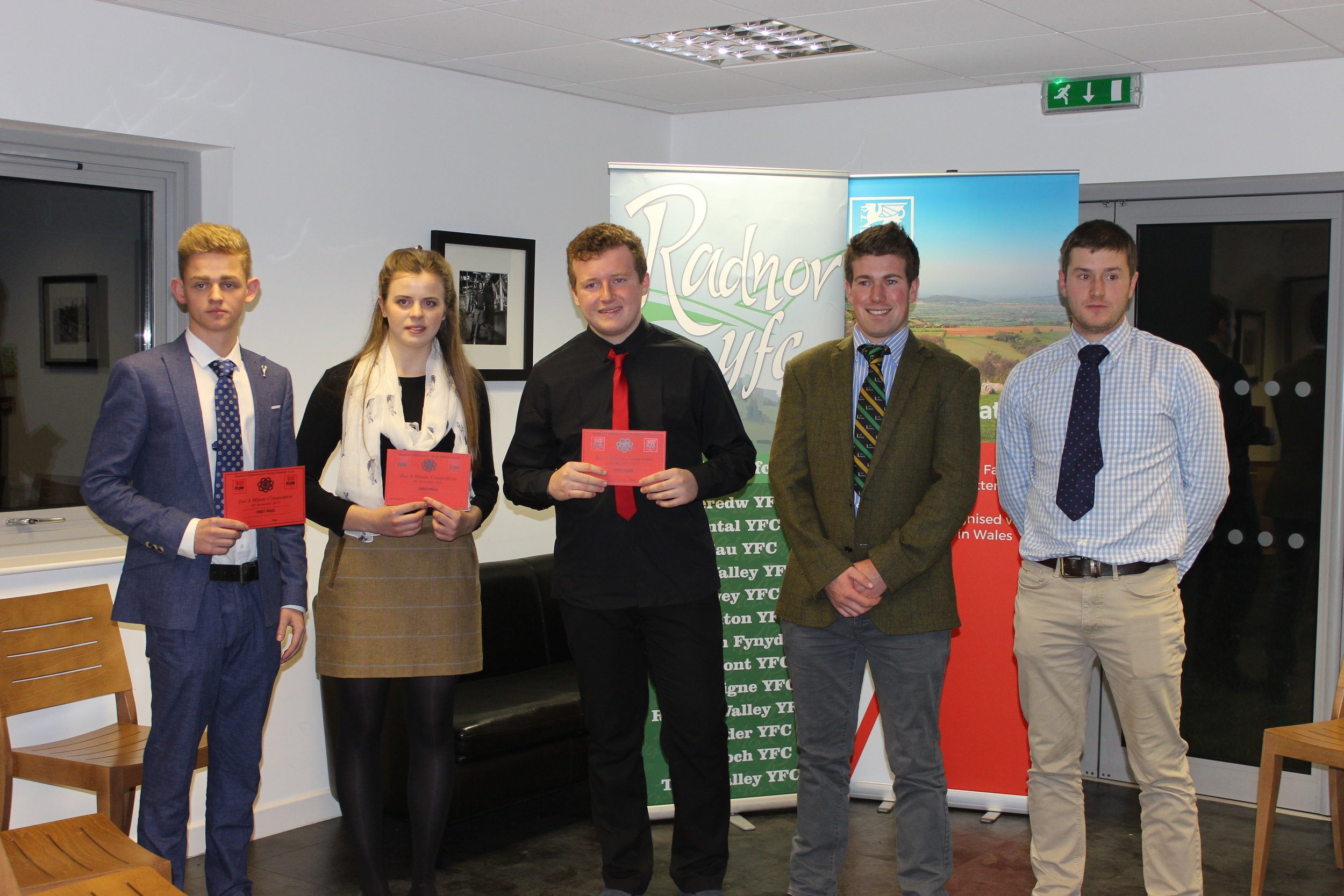 Ben Chilman & Elizabeth Preston, Presteigne YFC & Teddy Mitchell, Edw Valley YFC winning the Just A Minute Competition with judges Joe Williams & Mark Hanson.