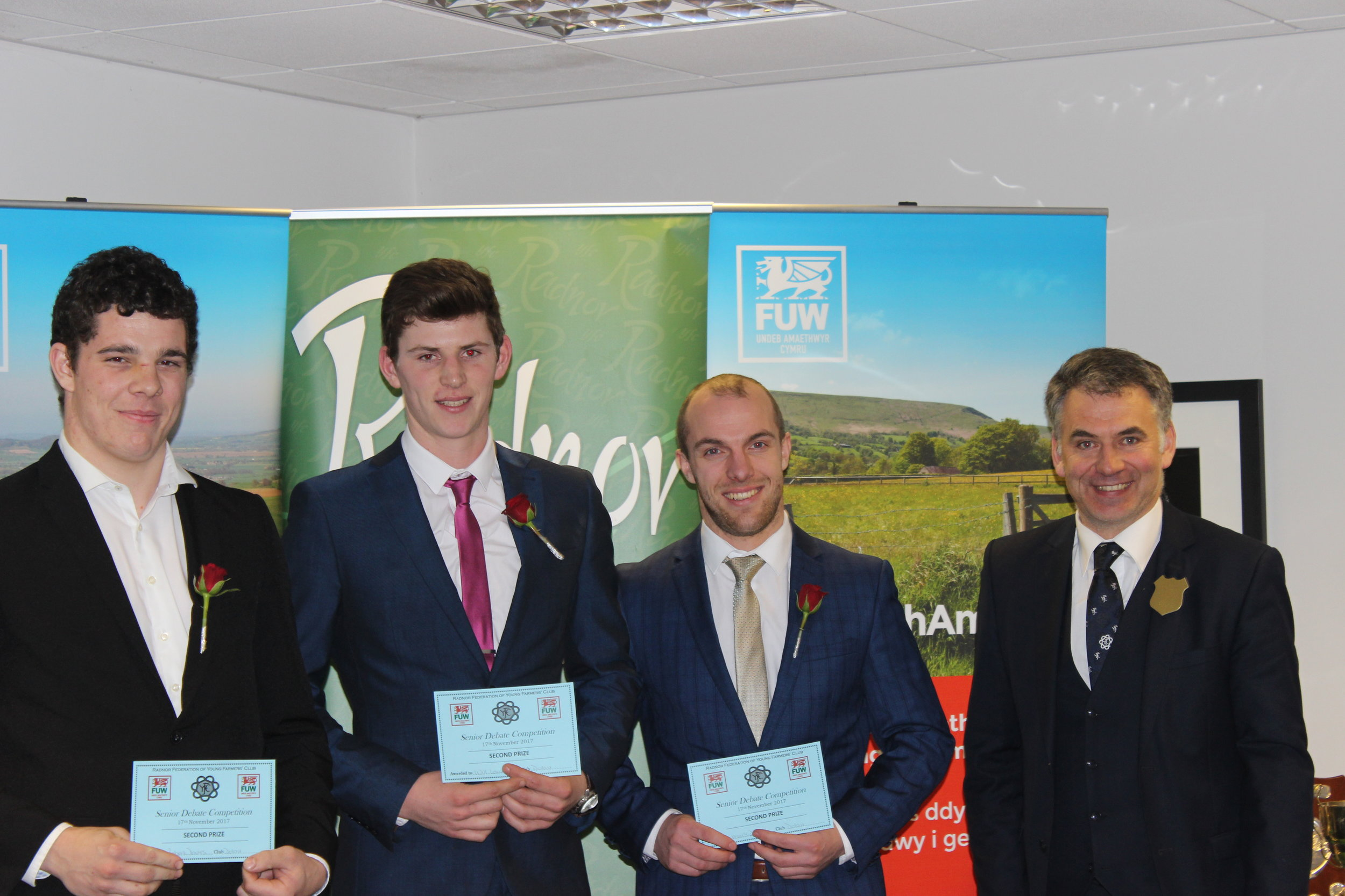 Robert Davies, Will Lewis & Mark Davies, Dolau YFC with judge Glenn Jones coming second in the Senior Debate competition.