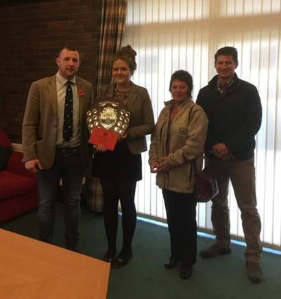 Gemma Price, Llanbadarn Fynydd YFC with Judges Owen Davies, Elaine Blair & Adam Rees with the Junior Member of the Year shield.