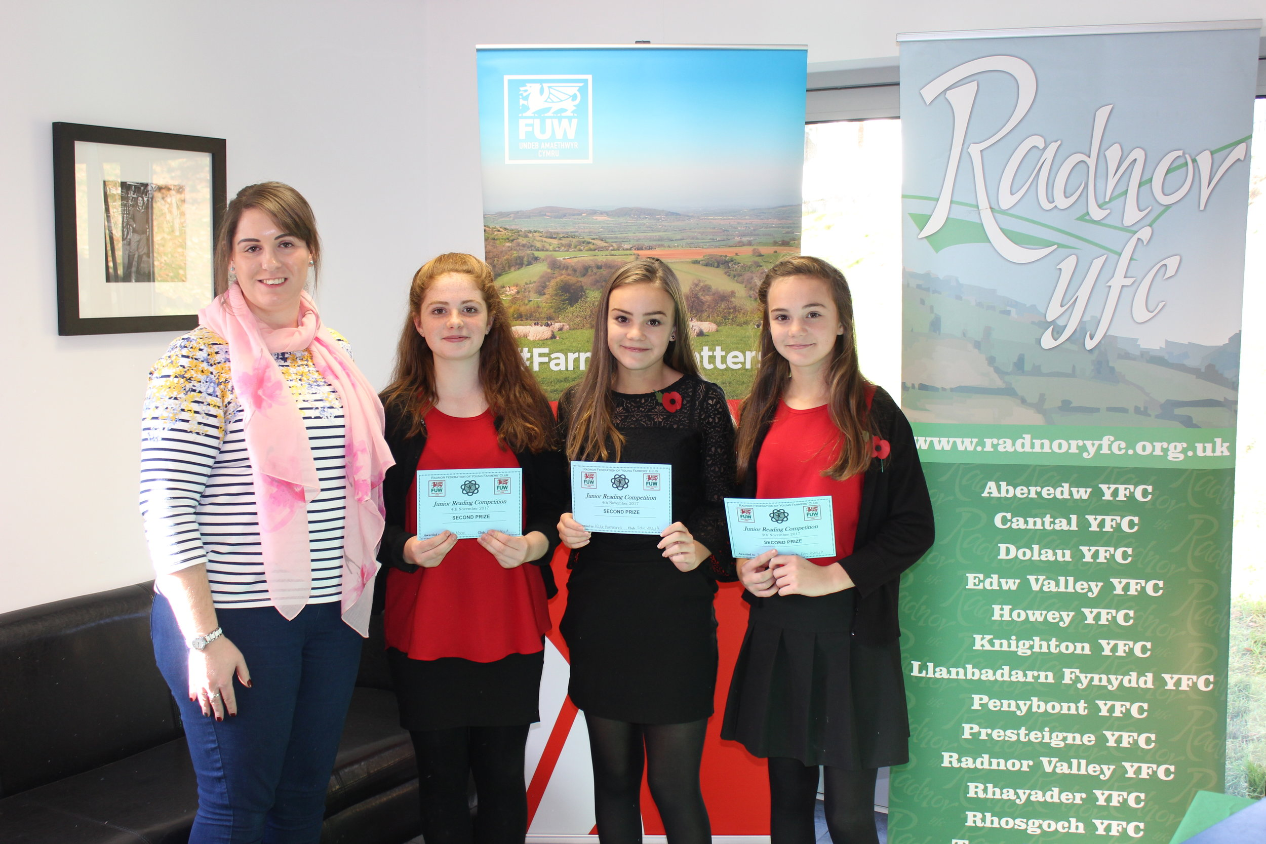 Carys Moore, Katie Hammonds & Evie Hammonds coming second in the Junior Reading competition with judge Emma Bayona Martinez.
