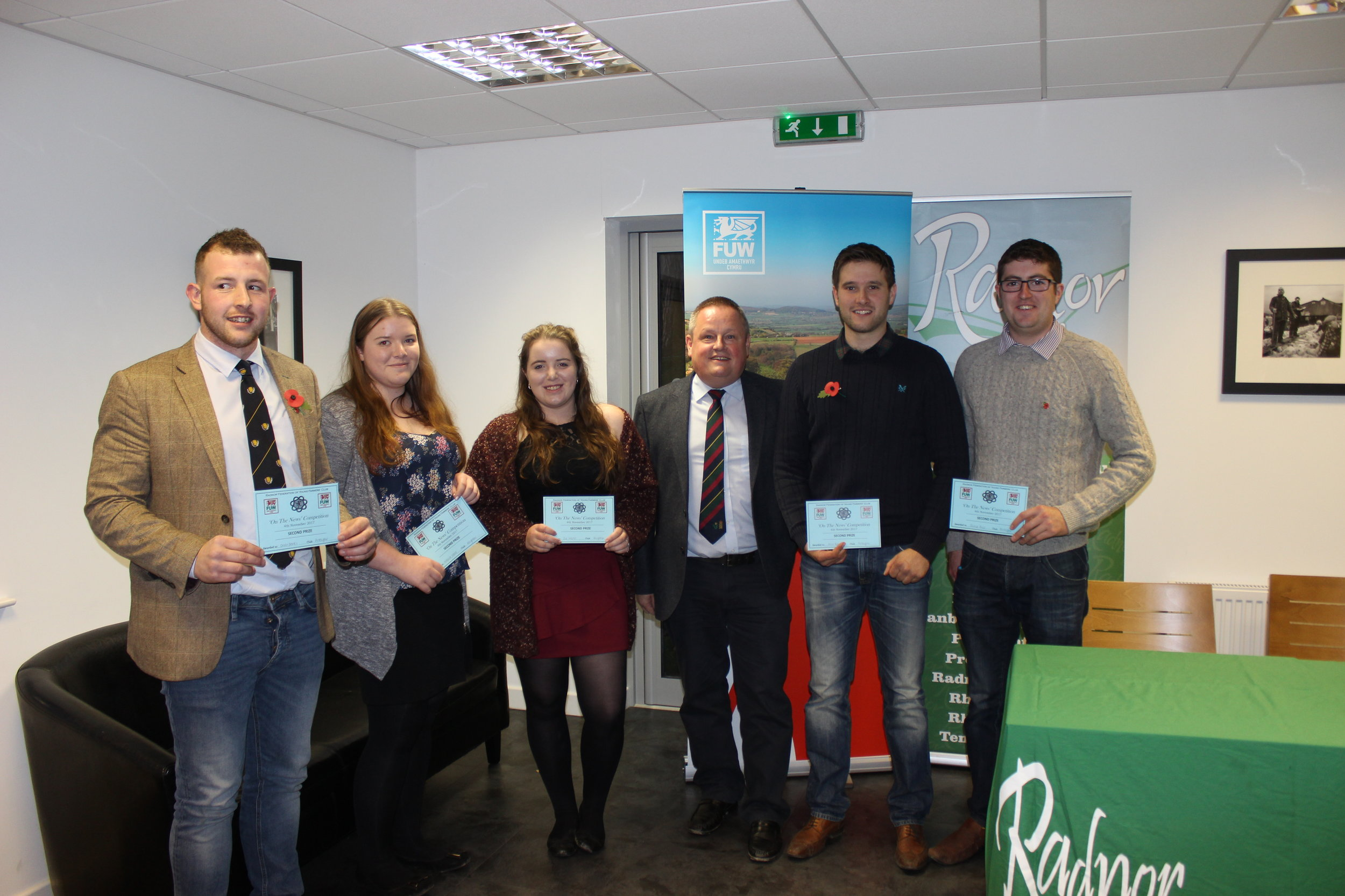 Owen Davies, Natalie Wood, Cerys Wood, William Rogers & Jamie Price, Presteigne YFC & Knighton YFC gaining joint 2nd in the 'On The News' Competition with judge Trevor Owens.