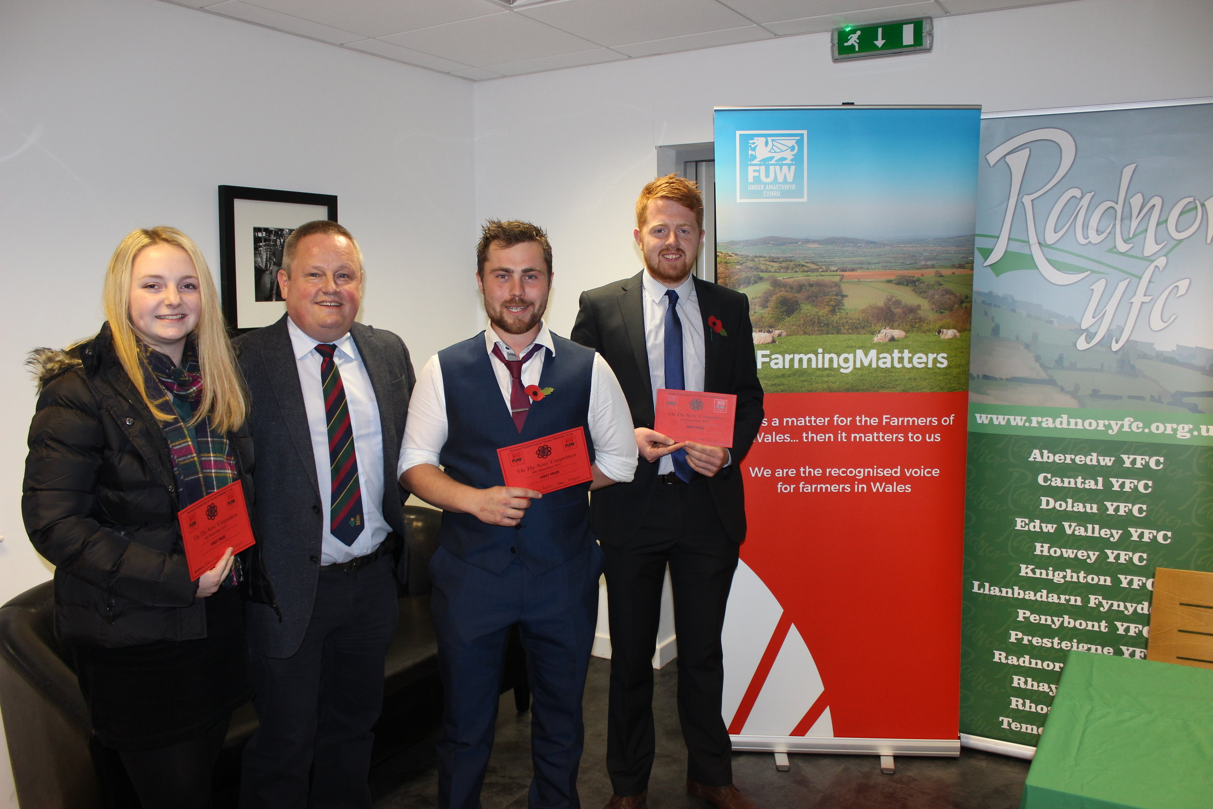 Rebecca Lloyd, James Poulton and Richard Meredith, Rhosgoch YFC with judge Trevor Owens winning the 'On The News' Competition.