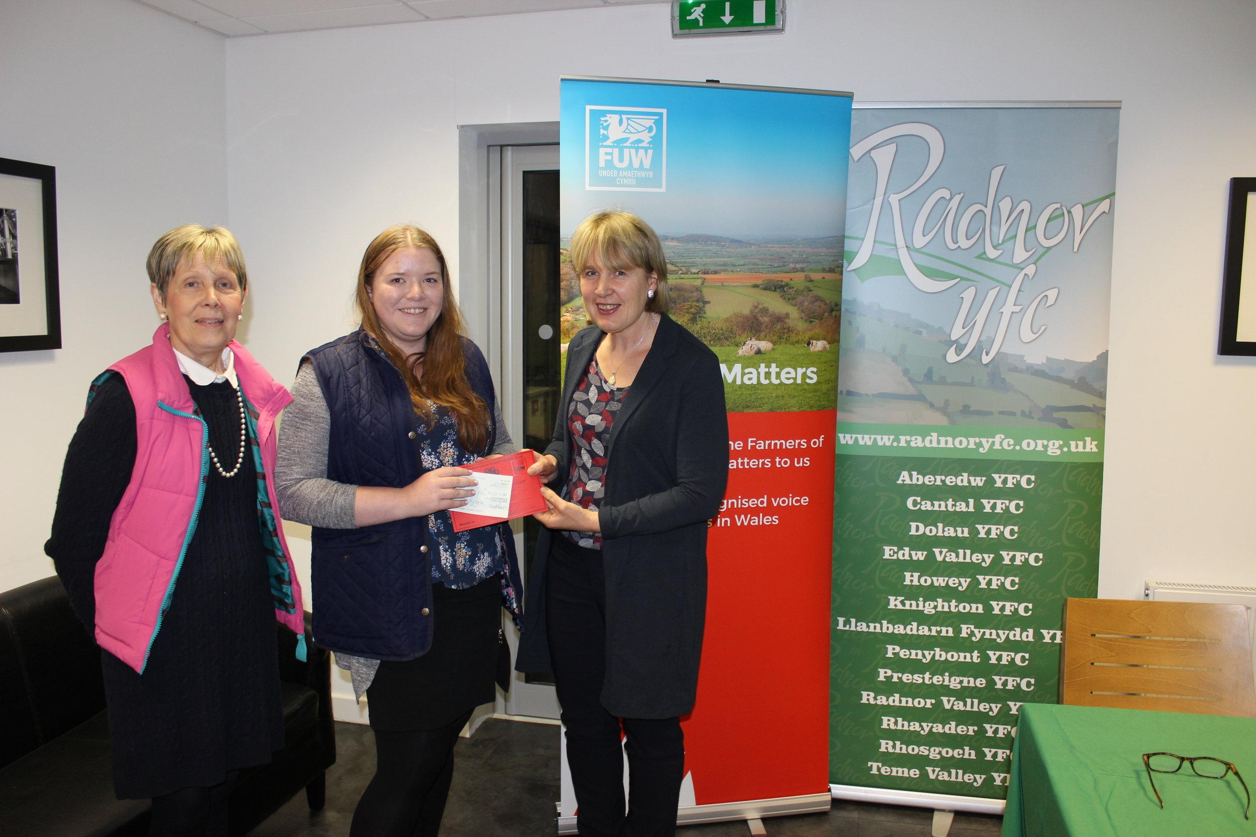 Natalie Wood, Knighton YFC winning the Bursary Competition with judges Rhian Duggan & Gill Price.