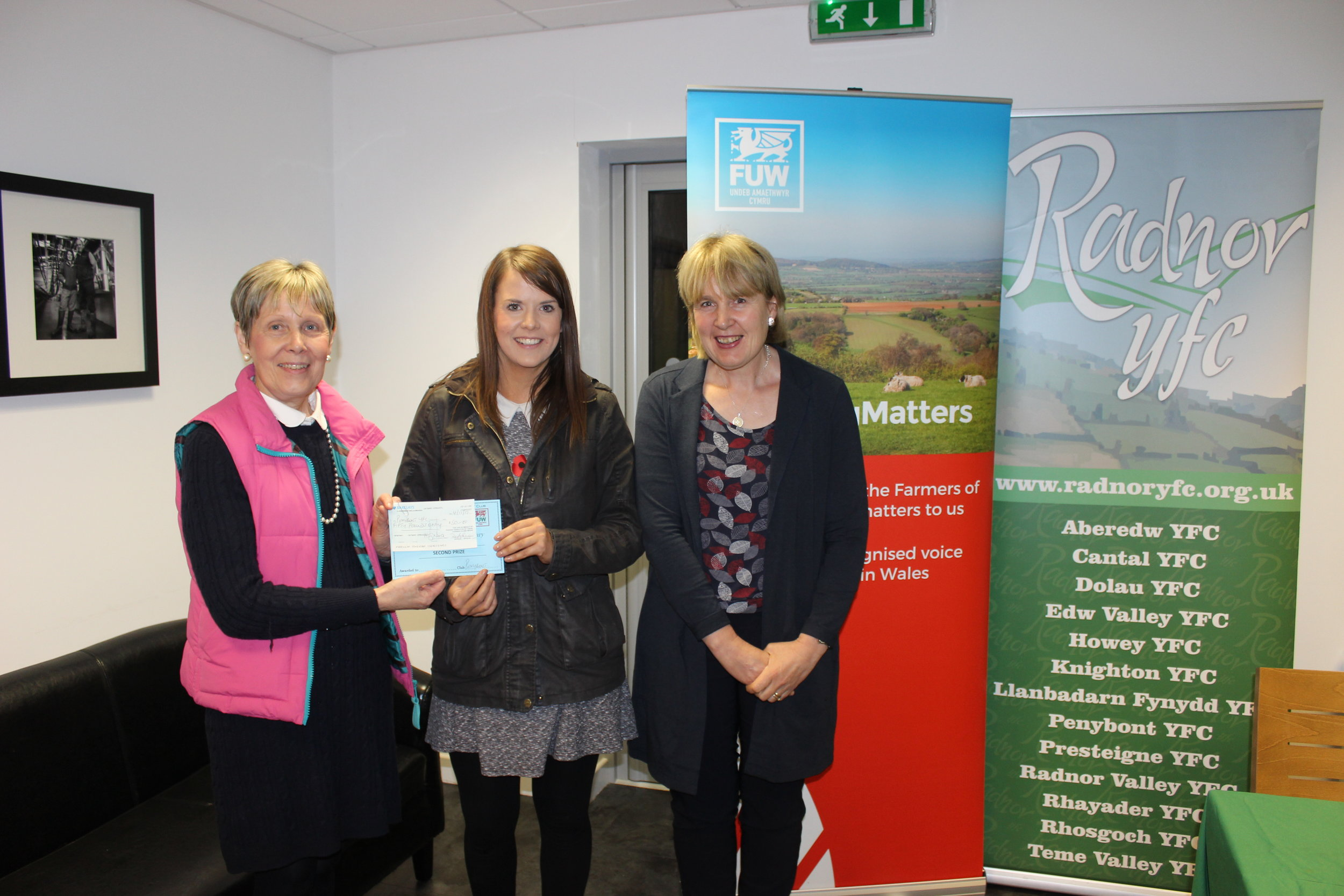 AJ Powell, Penybont YFC coming 2nd in the Bursary Competition with Judges Rhian Duggan & Gill Price.