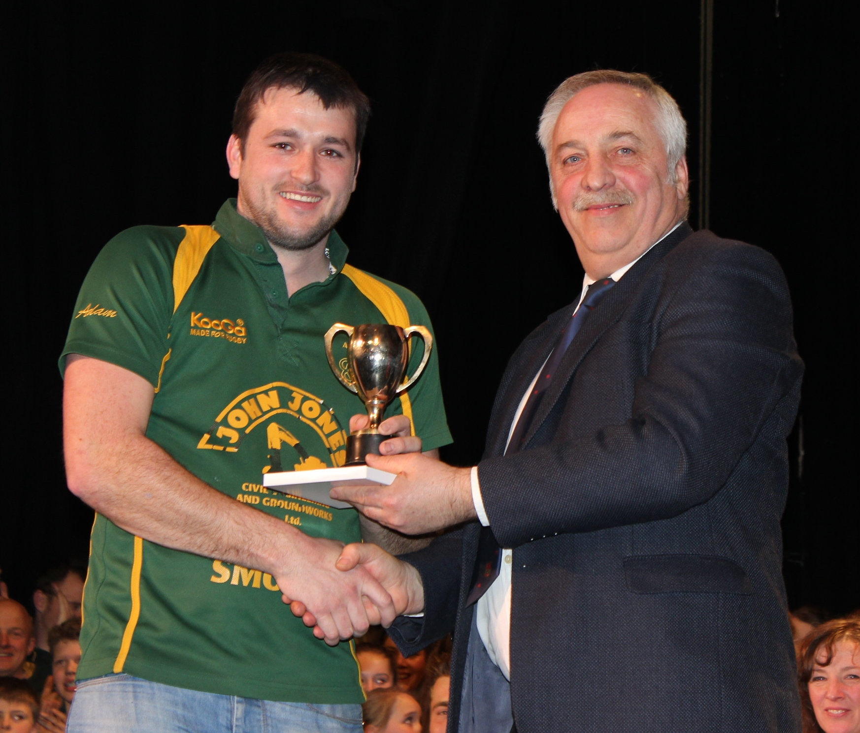 Adam Lewis, Aberedw YFC being presented with the 'Mr & Mrs R H Moseley Cup' for best individual male performance by David Powell, FUW