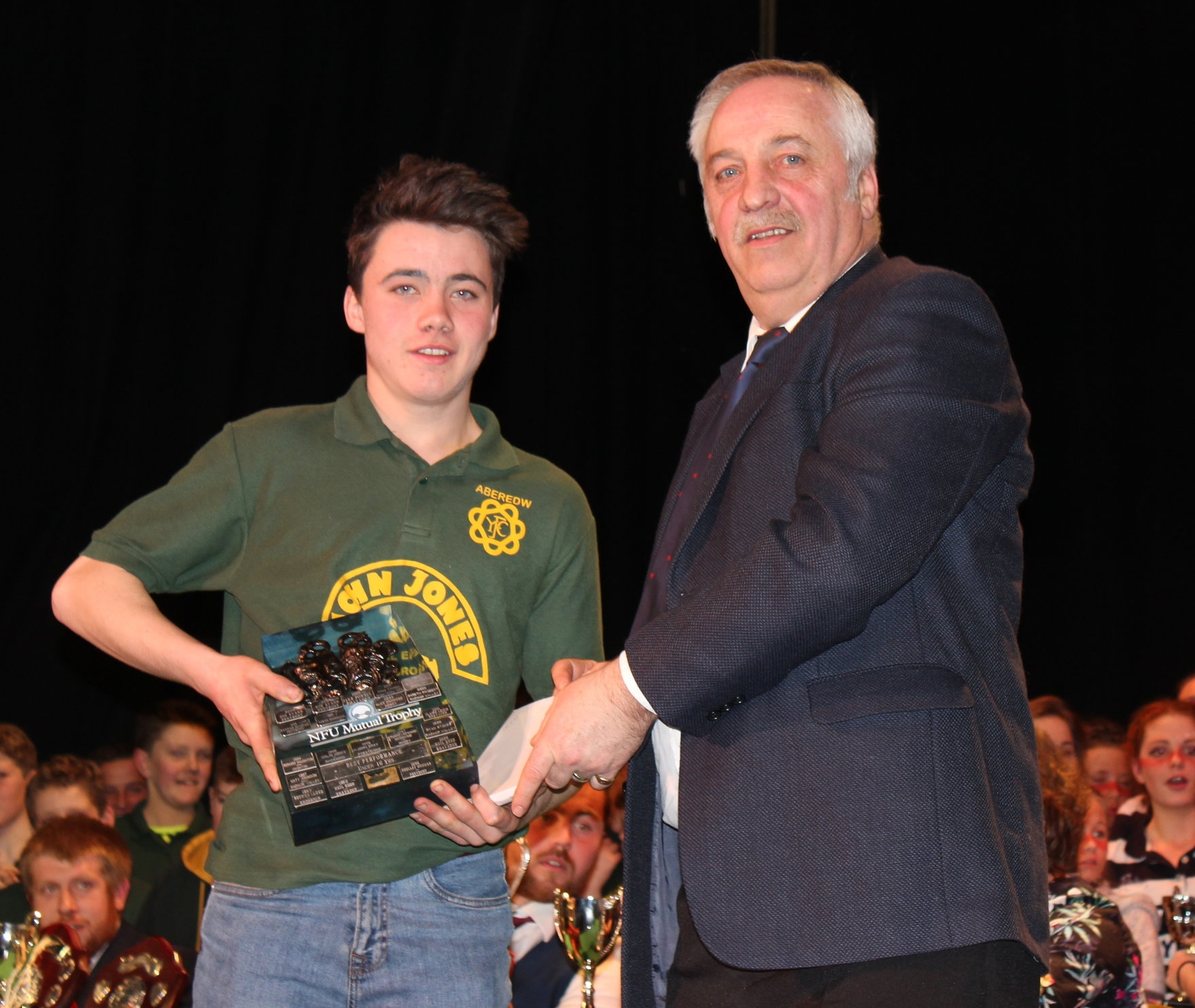 Rhys Morris, Aberedw YFC with the 'NFU Shield' for best performance 16 years and under being presented to by David Powell, FUW