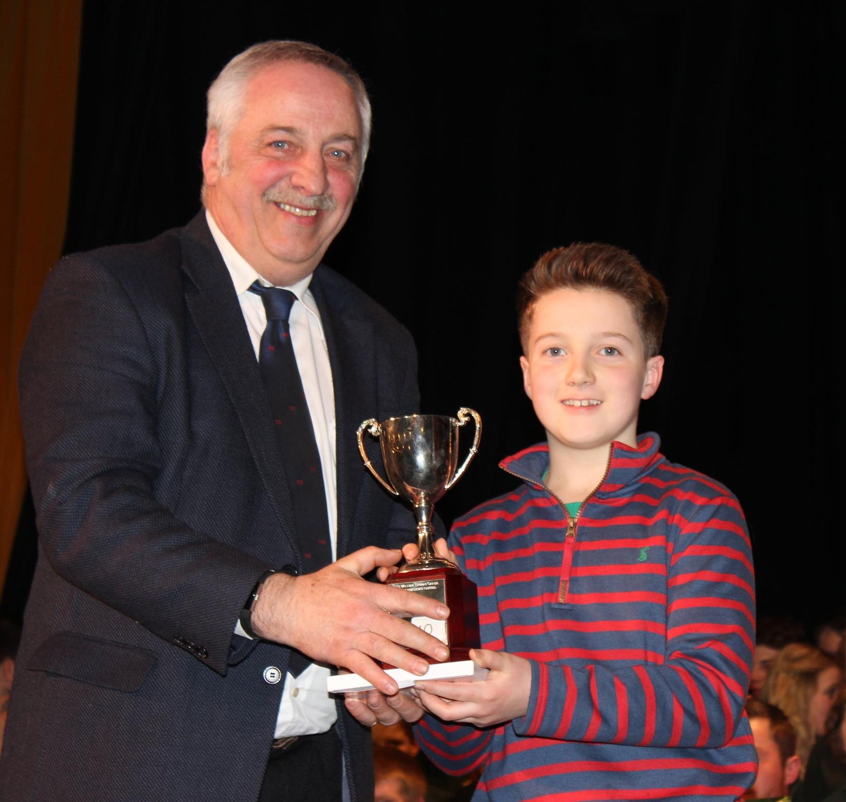 Louis Watkins, Dolau YFC winning the 'Midge Roderick Award' for best Actor under 13 years being presented by David Powell, FUW