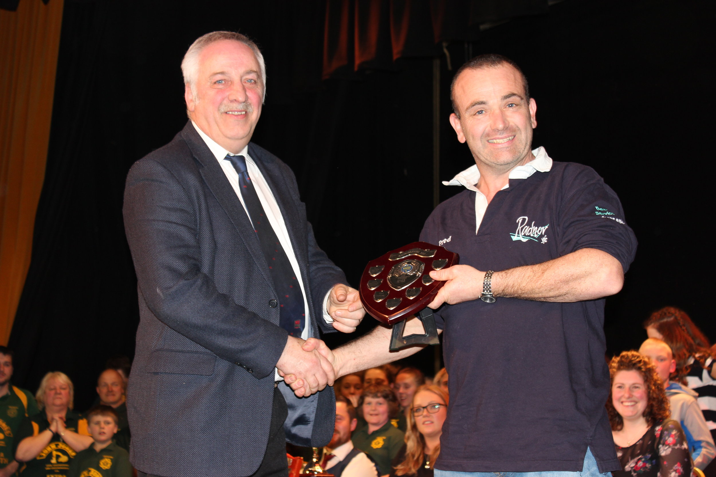 Fred Morris, Penybont YFC being presented the 'Hope Family Shield' for best costume by David Powell, FUW