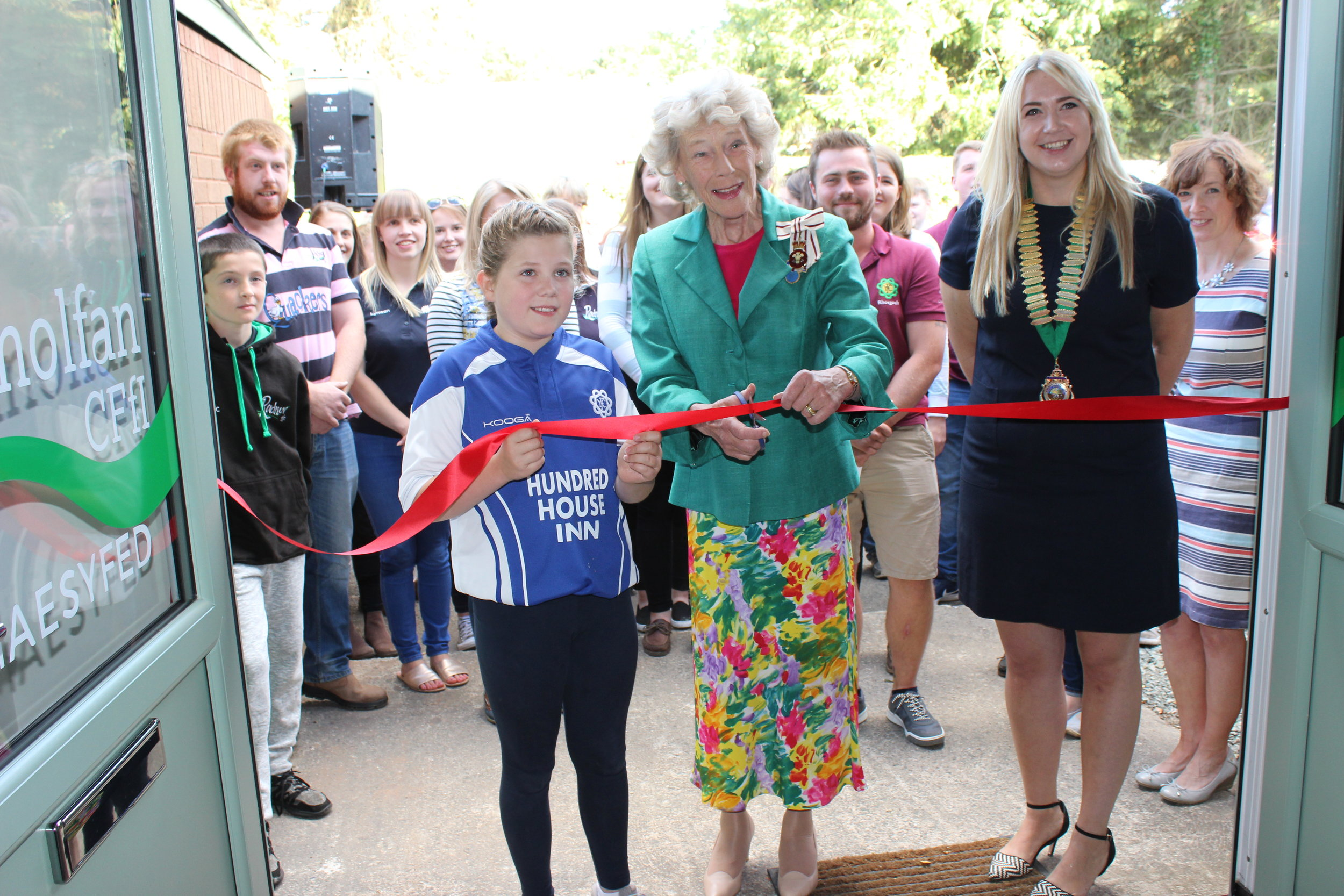 Youngest member of Radnor YFC Seren Price, Edw Valley YFC assisting Honourable Mrs Legge Bourke to officially open the Radnor YFC Centre with County Chairman Gemma Bufton.