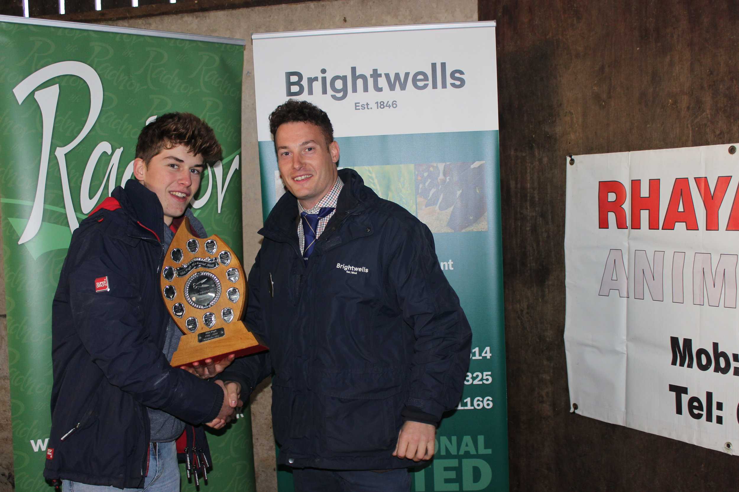 Thomas Swancott, Teme Valley YFC - Max Pugh Memorial Shield (Lamb Trimming) being presented by Matt Williams, Brightwells