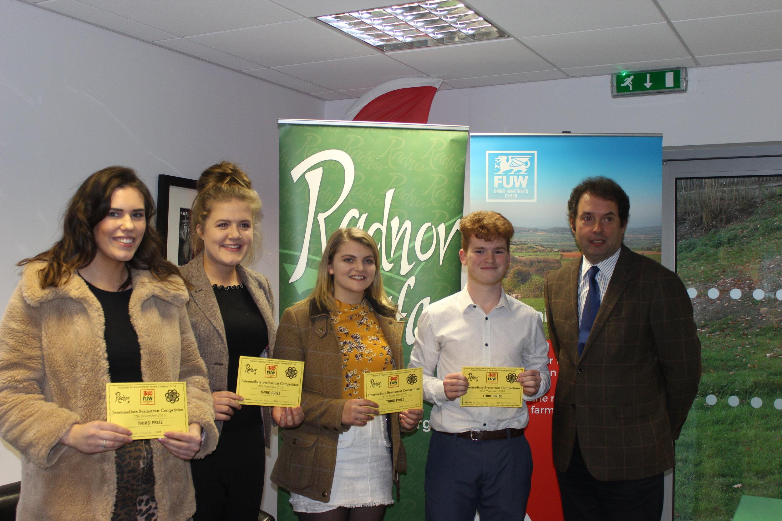 Sarah Meredith, Gemma Price, Annie Fairclough & Rhys Bennett, Llanbadarn Fynydd YFC coming 3rd place in the Intermediate Brainstrust with judge Alan Gardner.