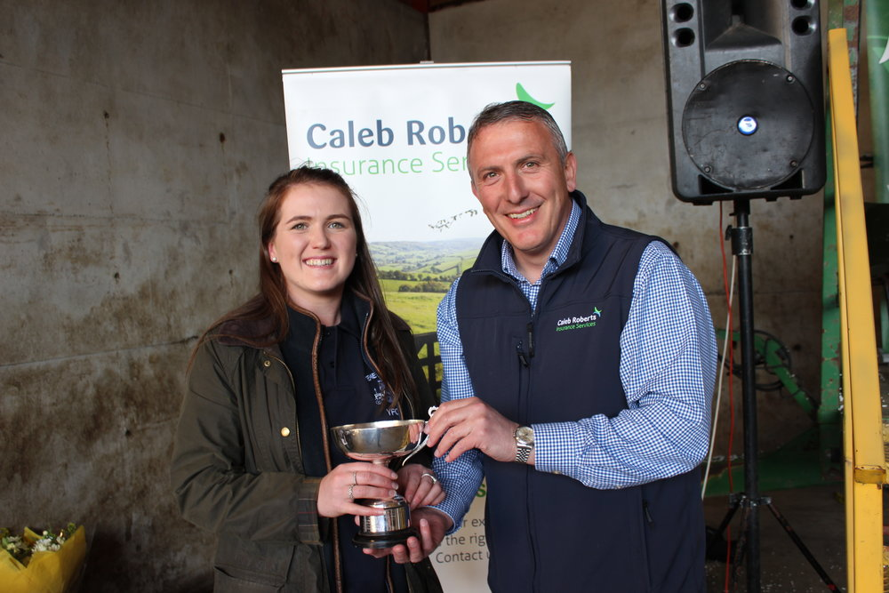 Ella Harris, Teme Valley YFC - Glenda Lawrence Cup for the Promotional Sign being presented by Hugh Campbell, Caleb Roberts.