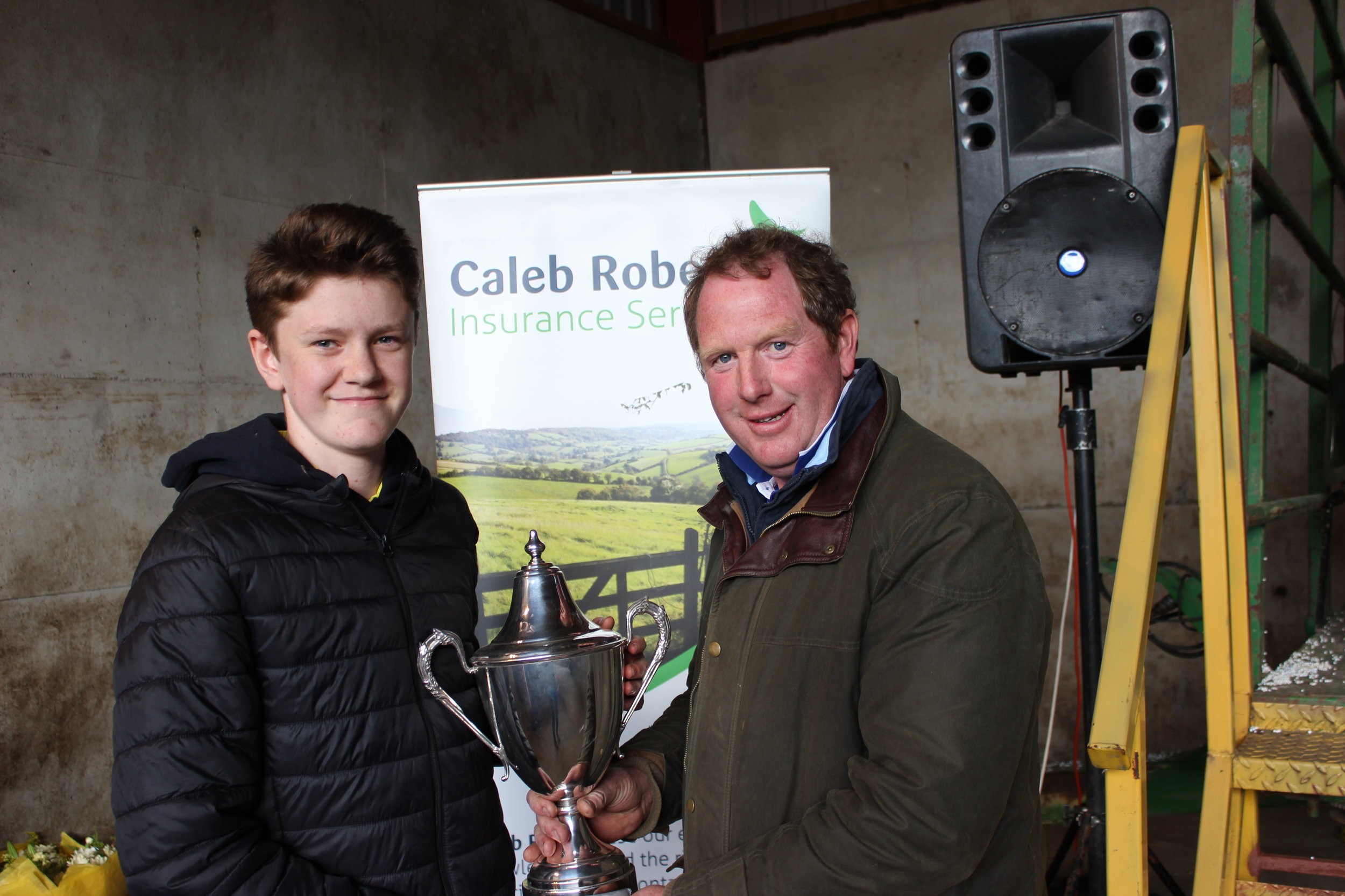 William Davies, Aberedw YFC - Jonathan Ruell Memorial Cup for highest mark in Stockjudging being presented by Rally Host, David Price.