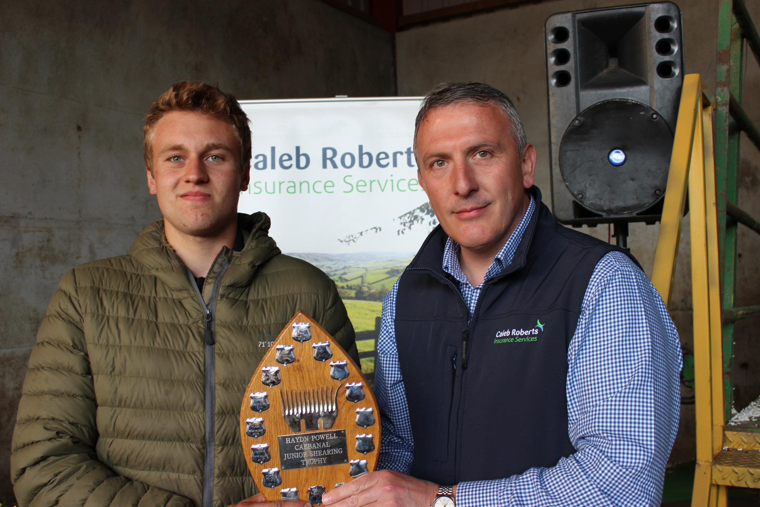 Philip Price, Radnor Valley YFC - Haydn Powell Trophy for the Junior Shearing being presented by Hugh Campbell, Caleb Roberts.