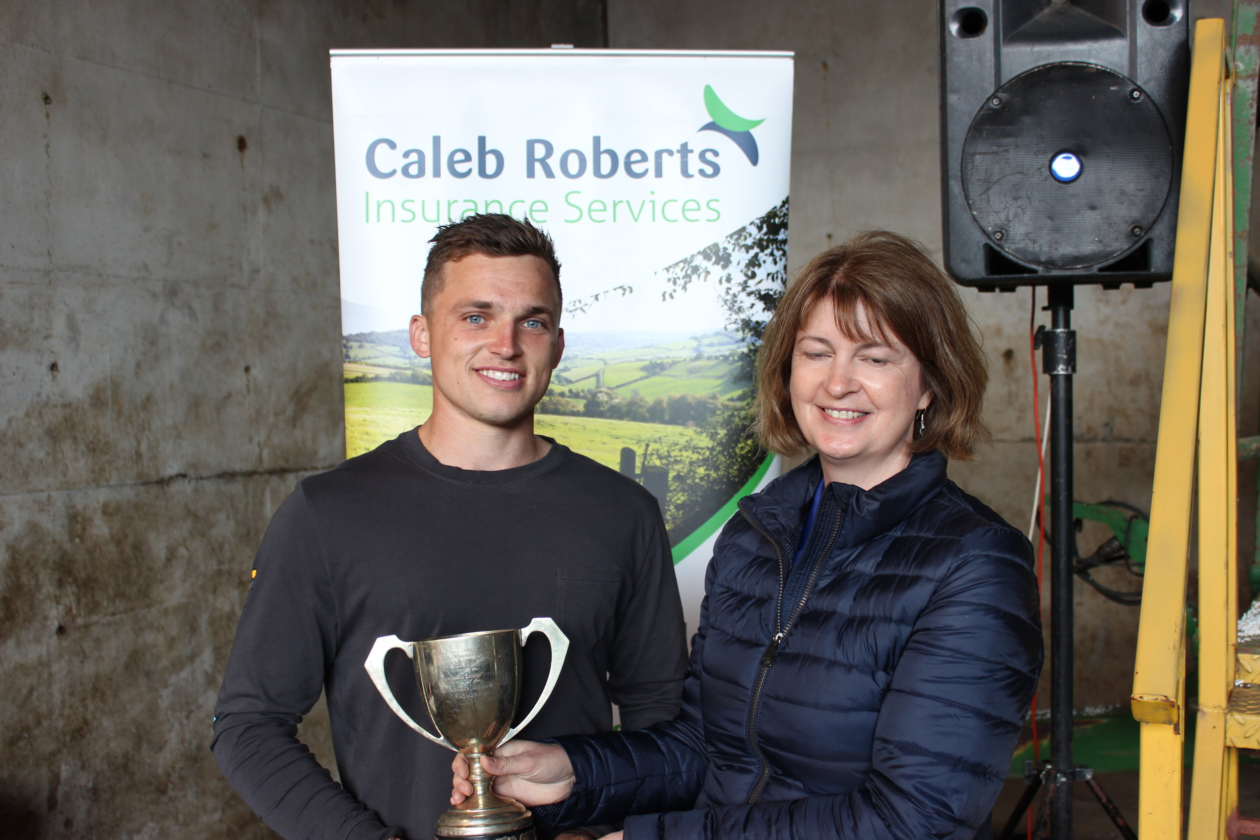 Aled Preece, Radnor Valley YFC - The RA Lister Trophy for Senior Shearing being presented by Rally Host, Debbie Price.