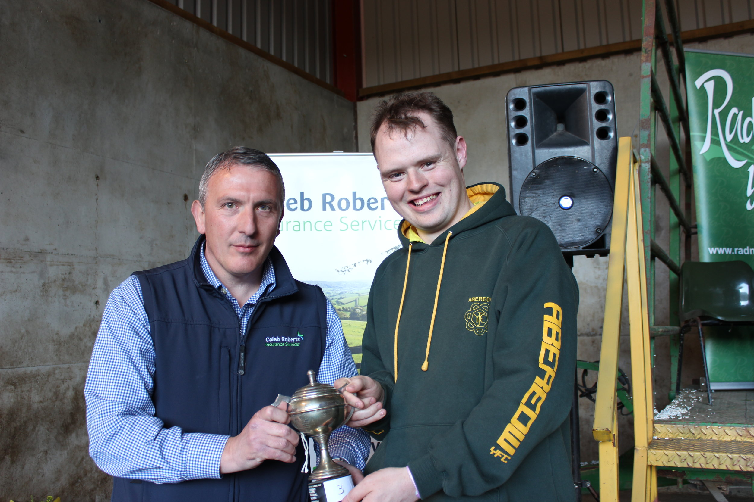 Owen Eckley, Aberedw YFC - Bevan Lewis Cup for third place being presented by Hugh Campbell, Caleb Roberts.