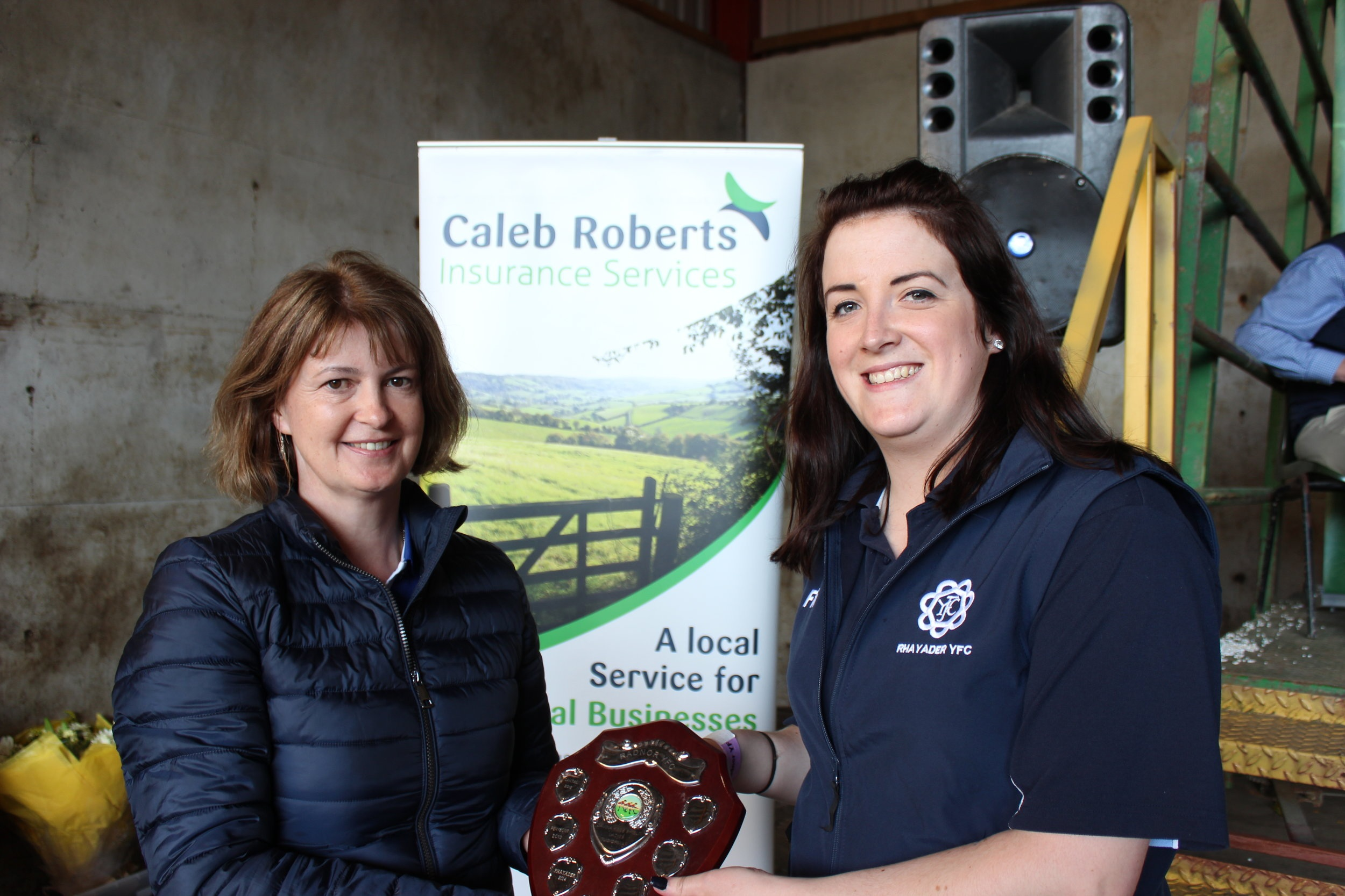 Ffion Mills, Rhayader YFC being presented with the Tug of War Shield for the Mens & Ladies competitions by Rally Host Debbie Price.