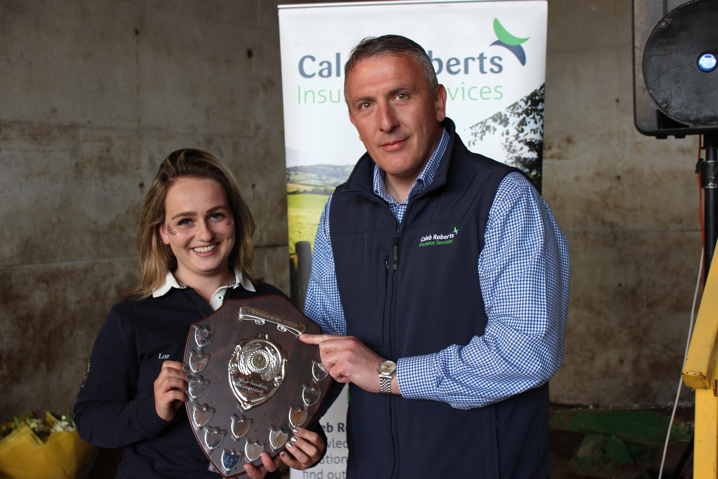 Lauren Morris, Radnor Valley YFC - Cwmyrhiewdre Shield for the Wool Handling competition being presented by Hugh Campbell, Caleb Roberts.