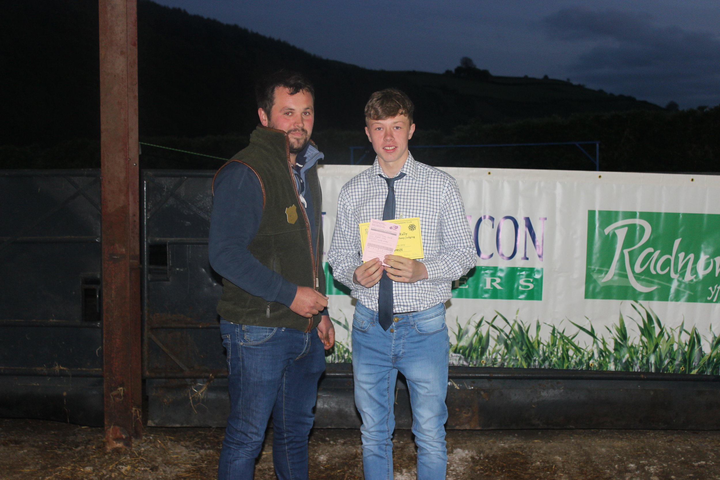 Ewan Davies, Radnor Valley YFC - 3rd place in the Under 18 Welsh Mule Stockjudging with Judge Will Jones.
