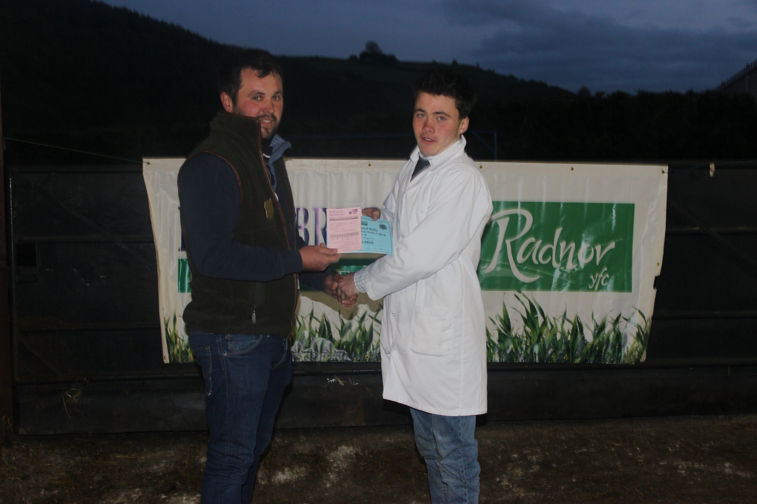 Rhys Morris, Aberedw YFC - 2nd place in the Under 18 Welsh Mule Stockjudging with Judge Will Jones.