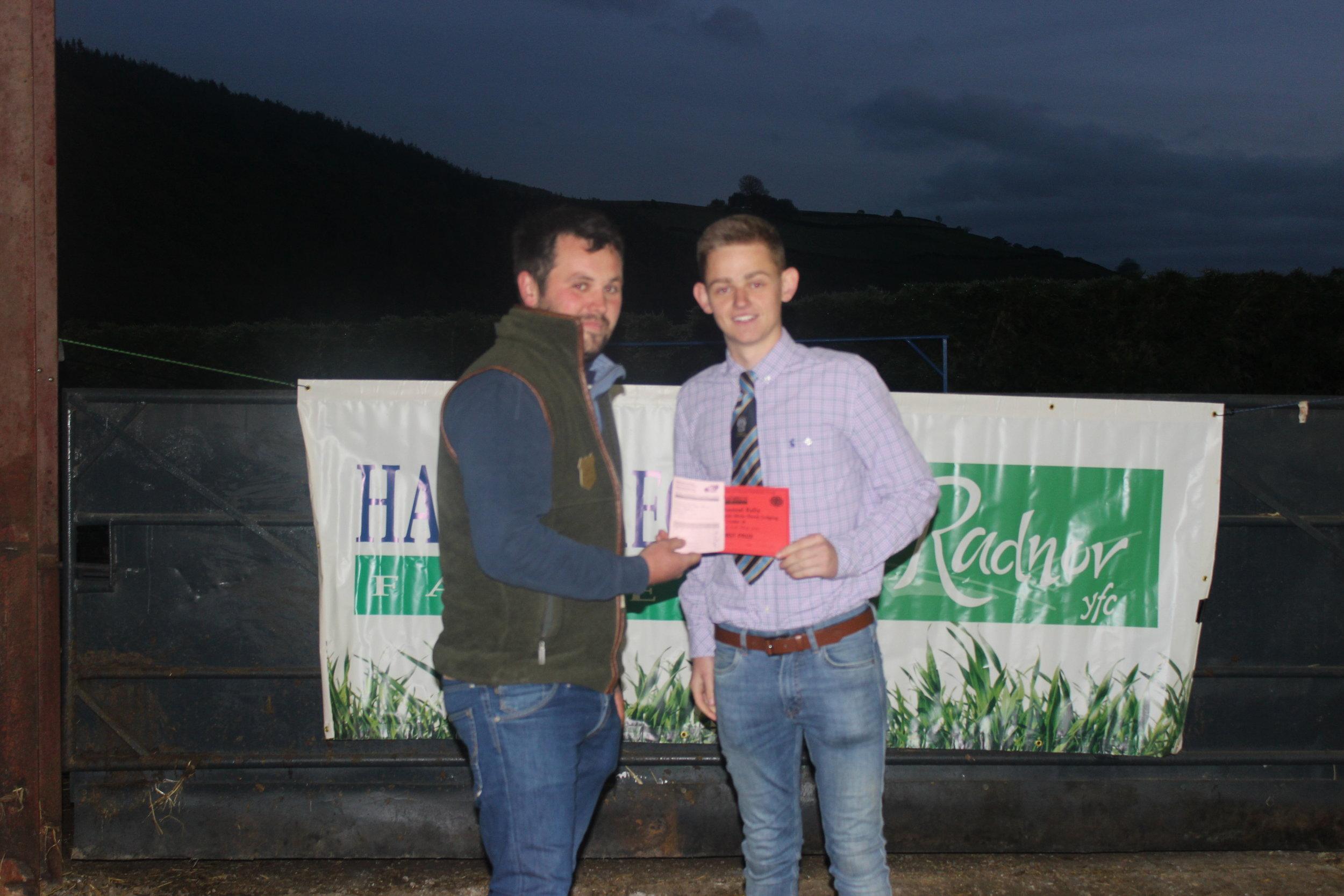 Ben Chilman, Presteigne YFC - 1st place in the Under 18 Welsh Mule Stockjudging with Judge Will Jones.