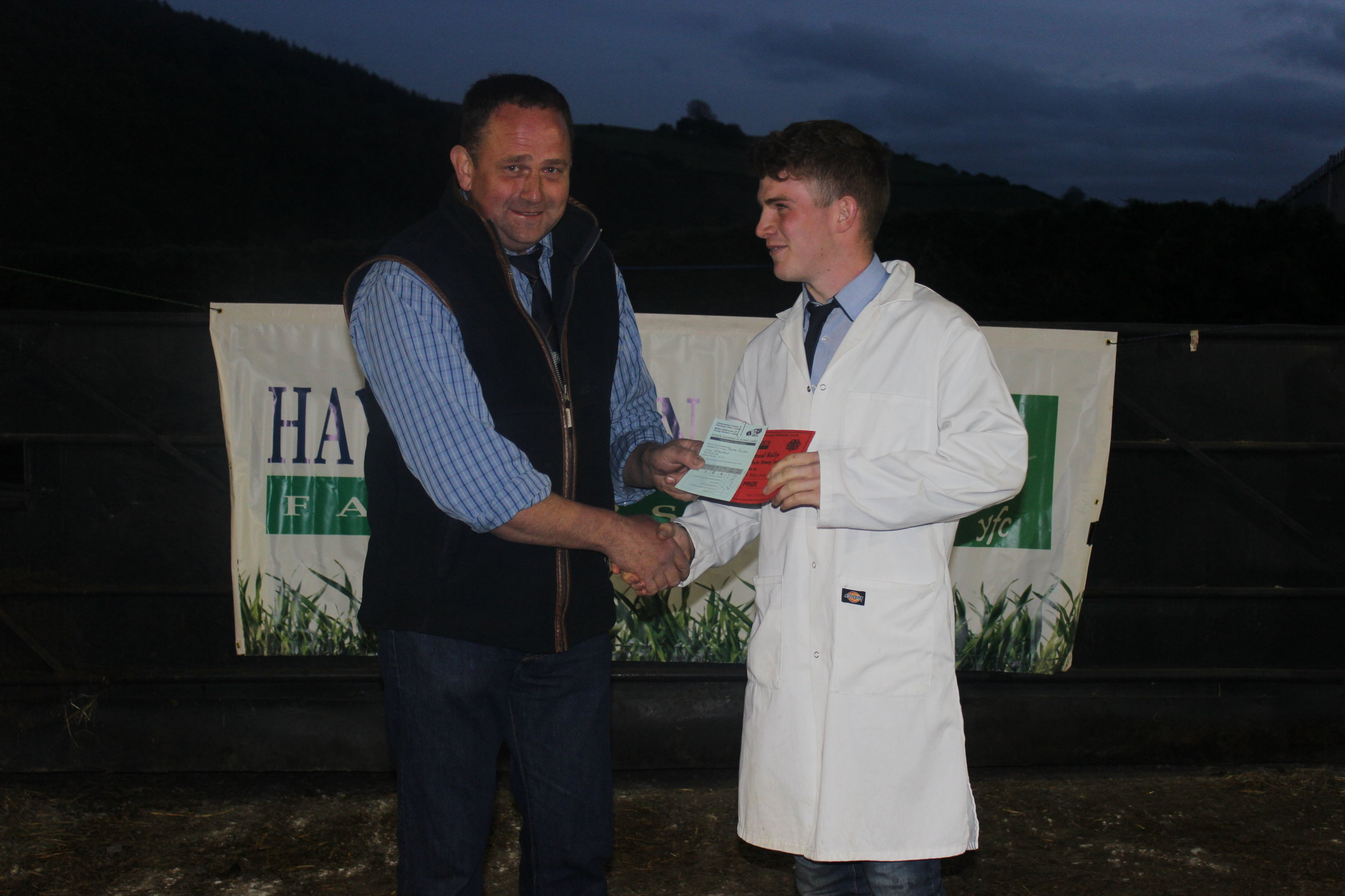 Aeron Powell, Aberedw YFC - 1st place in Under 21 Welsh Mule Stockjudging with Judge Geoff Probert.