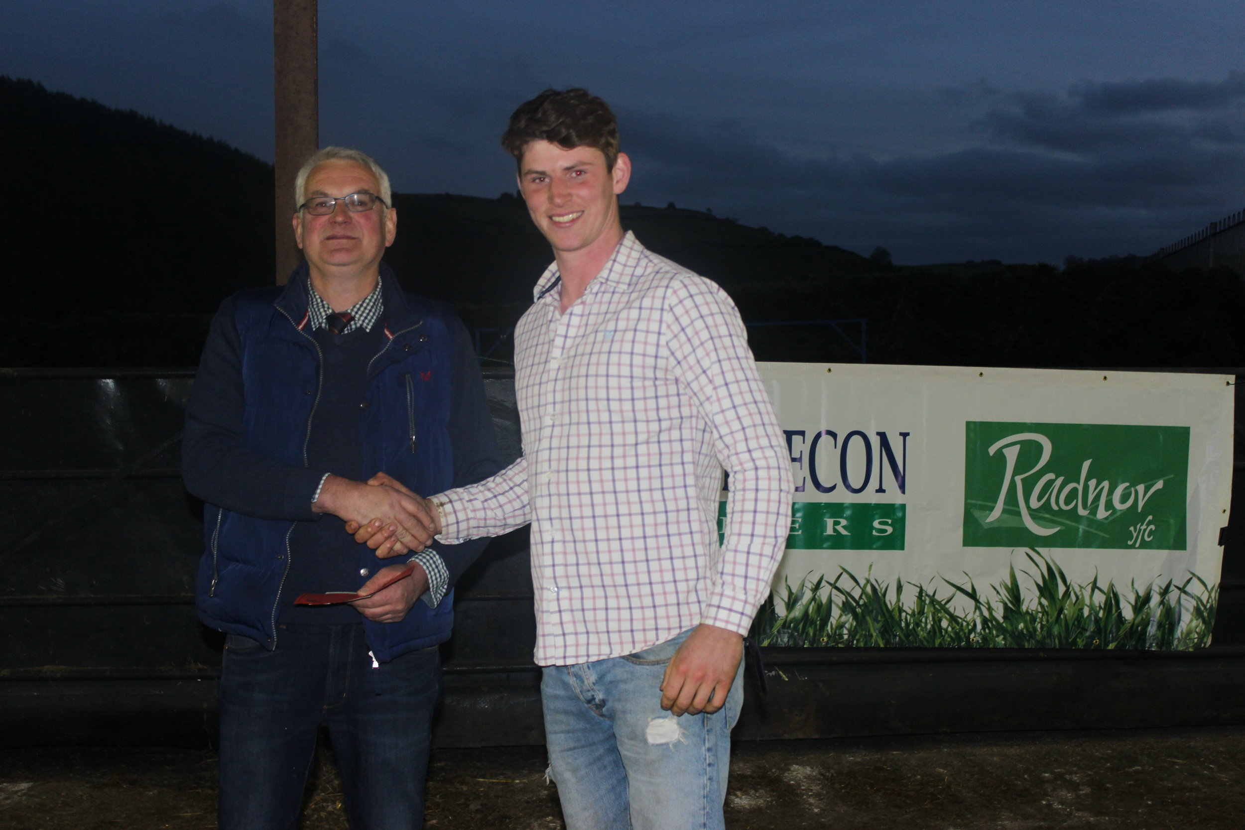 Will Lewis, Dolau YFC - 1st Place in the Under 26 Welsh Mule Stockjudging with Judge Morton Powell.