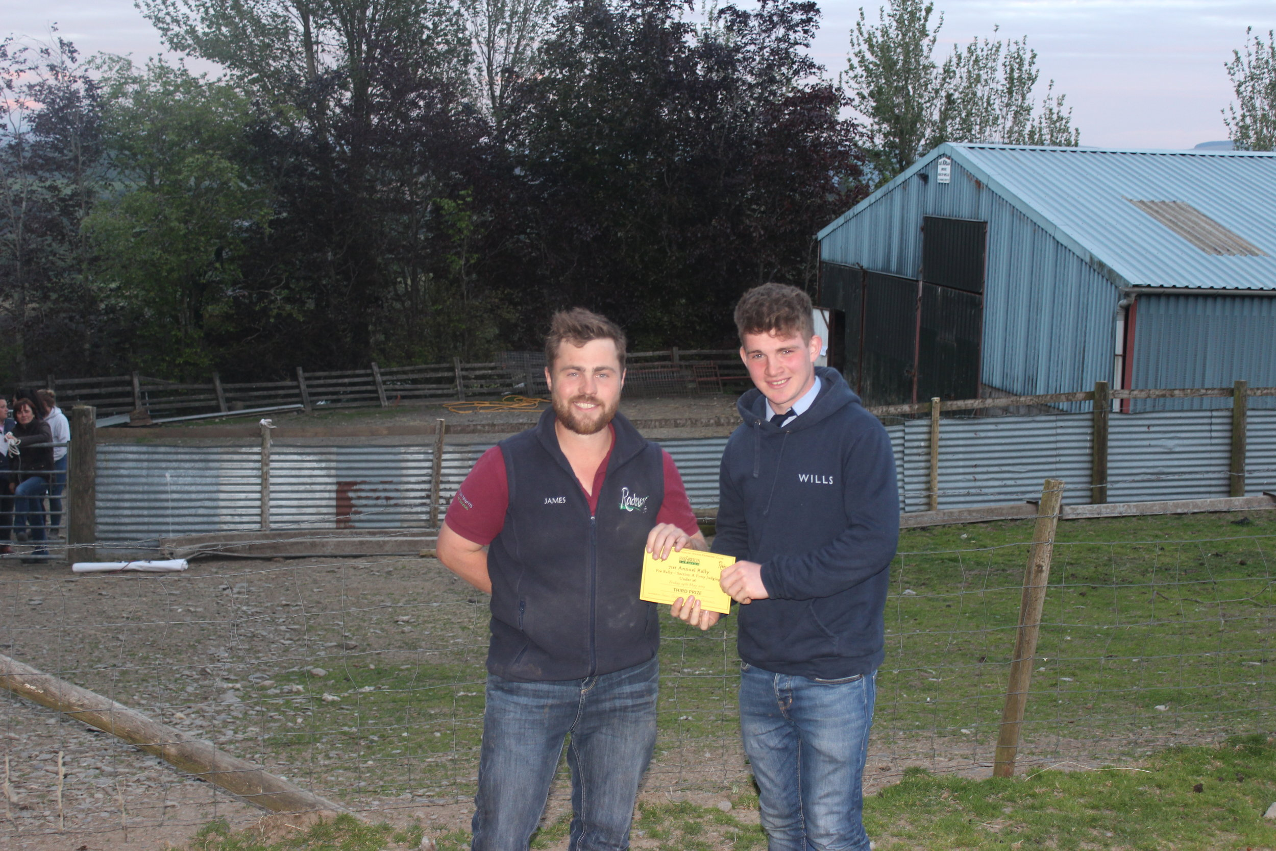Aeron Powell, Aberedw YFC - 3rd place in the Under 26 Section A Stockjudging with County Chairman James Poulton.