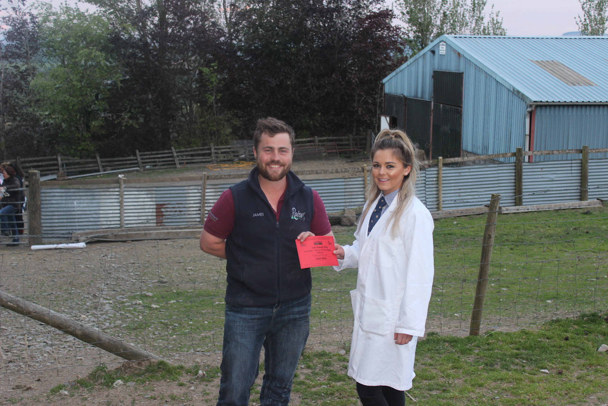 Ellie Owens, Presteigne YFC - 1st place in the Under 26 Section A Stockjudging with County Chairman James Poulton.