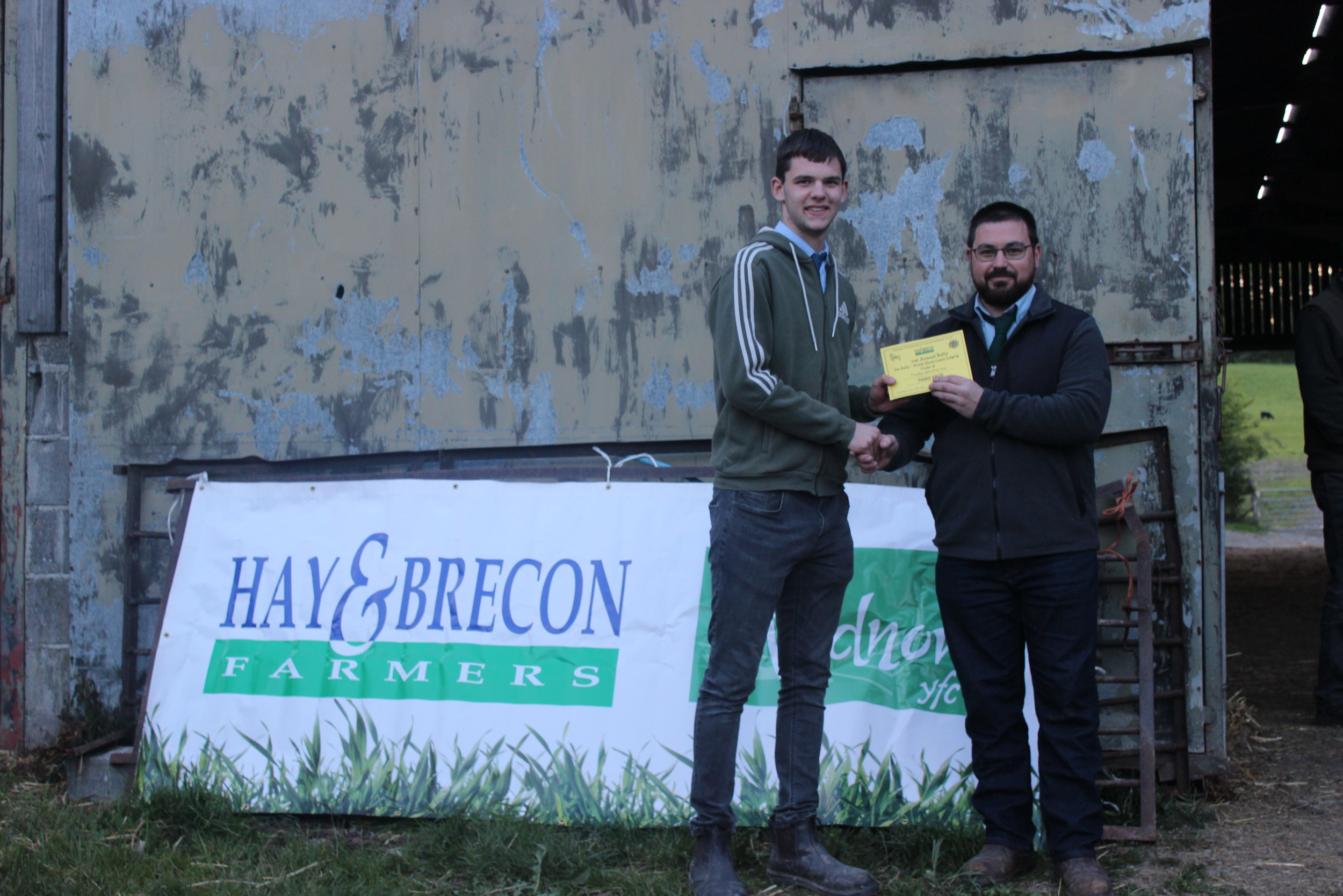Dan Powell, Penybont YFC - 3rd place in the Welsh Black Cattle judging with Judge