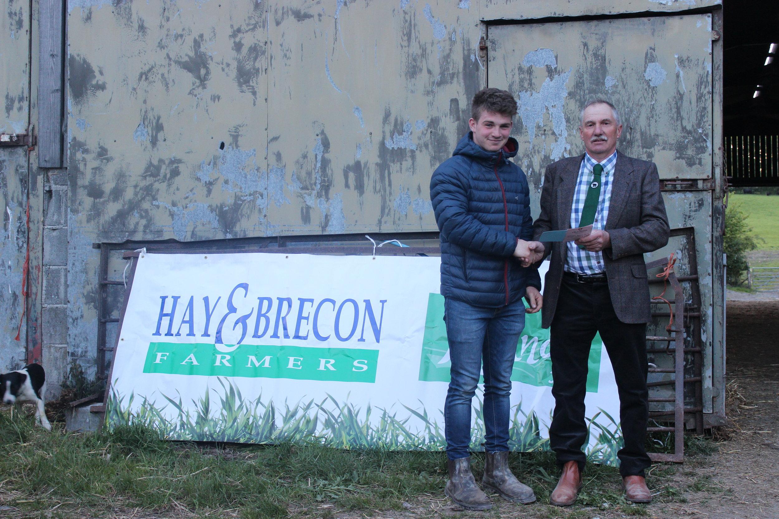 Aeron Powell, Aberedw YFC - 2nd in the Under 21 Welsh Black Cattle Stockjudging with Judge