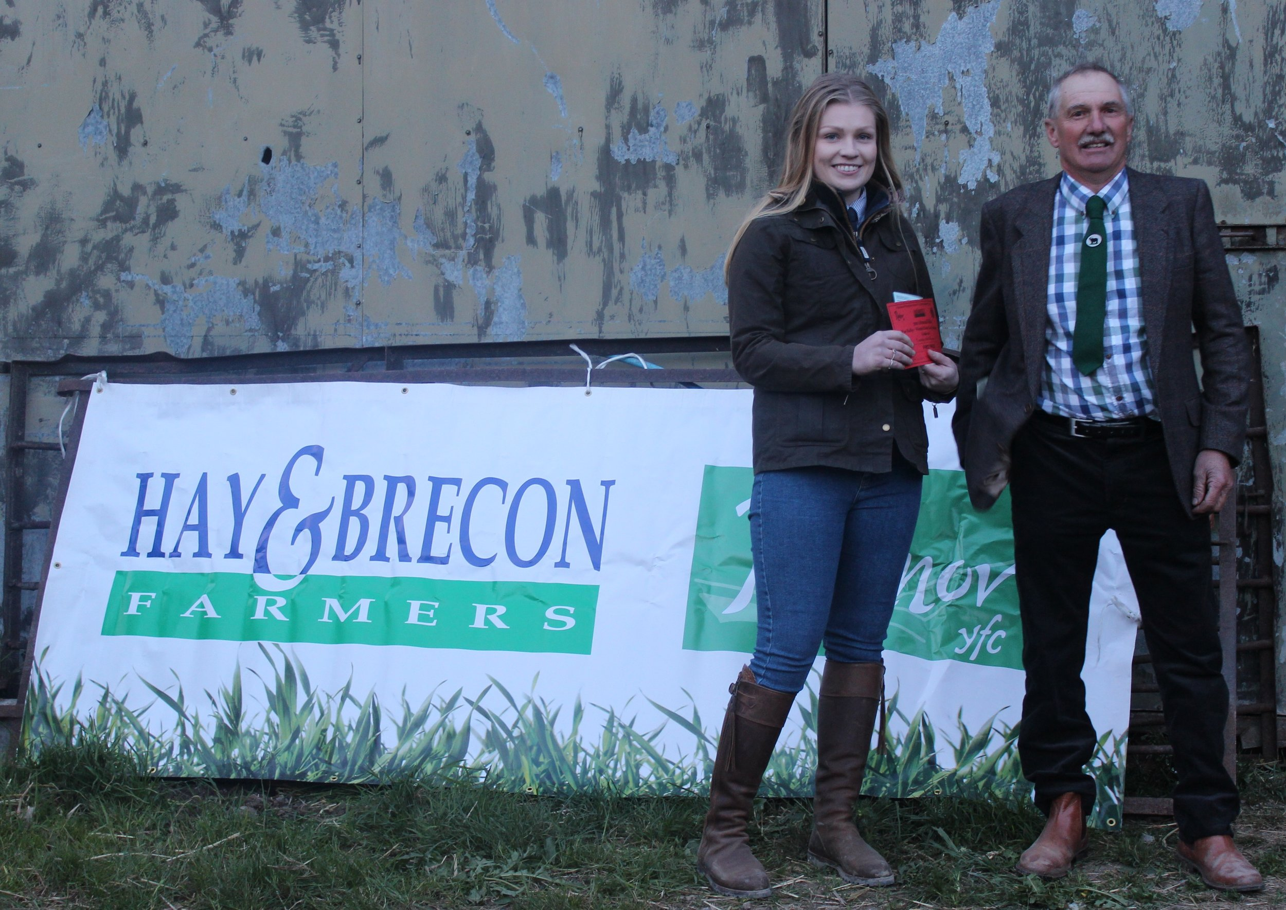 Sioned Price, Knighton YFC - 1st place in the Under 26 Welsh Black Cattle Stockjudging with Judge