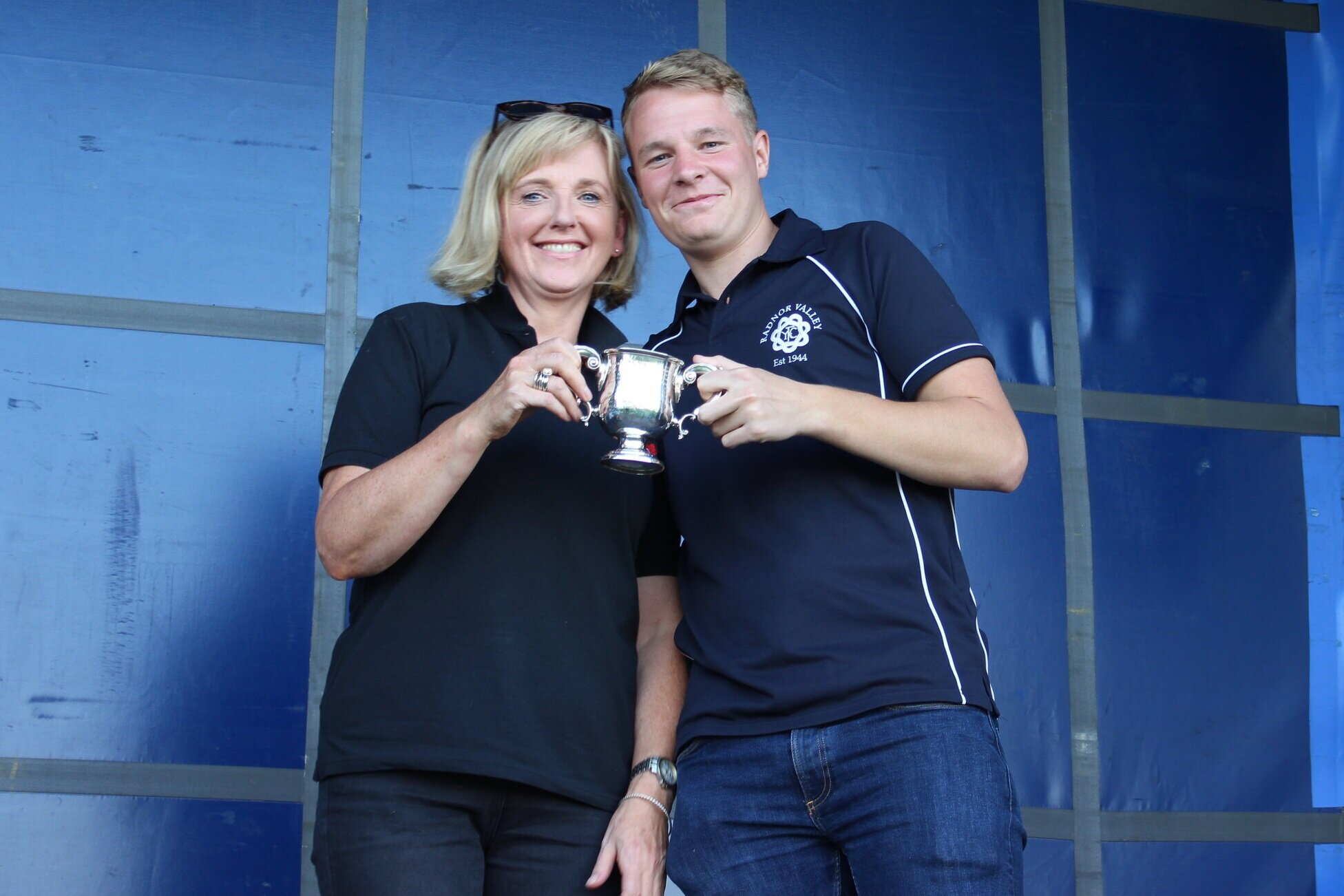 Louise Pugh presenting Club Chairman of Radnor Valley YFC with the 'Hector Morris Challenge Cup' for th most marks gained in the Home Crafts section.