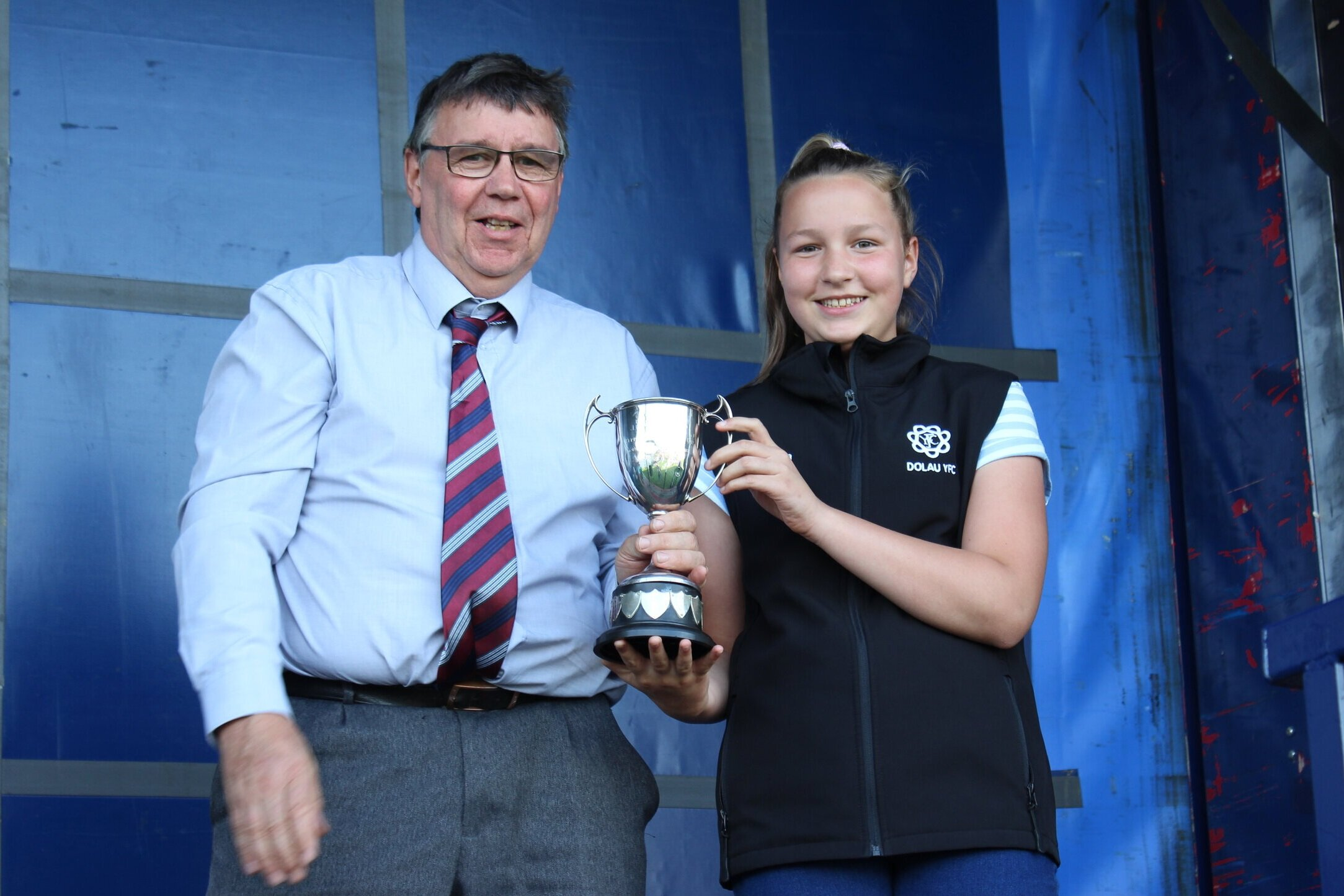 Mervyn Thomas presenting Nia Thomas, Dolau YFC with the 'J&P Turner' trophy for the highest marks gained in Class 1.