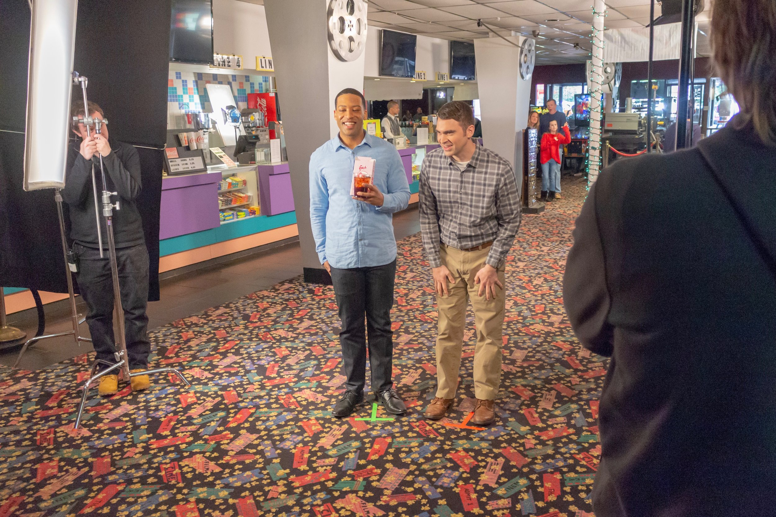 In the lobby of Mission Valley Cinema, Loosha Jones (left) and Jordan Estes rehearse a key scene for the  Oh Crappy Day  feature. Photo by Jonathan Okafo. Copyright © 2019 Dagtype Films, LLC.