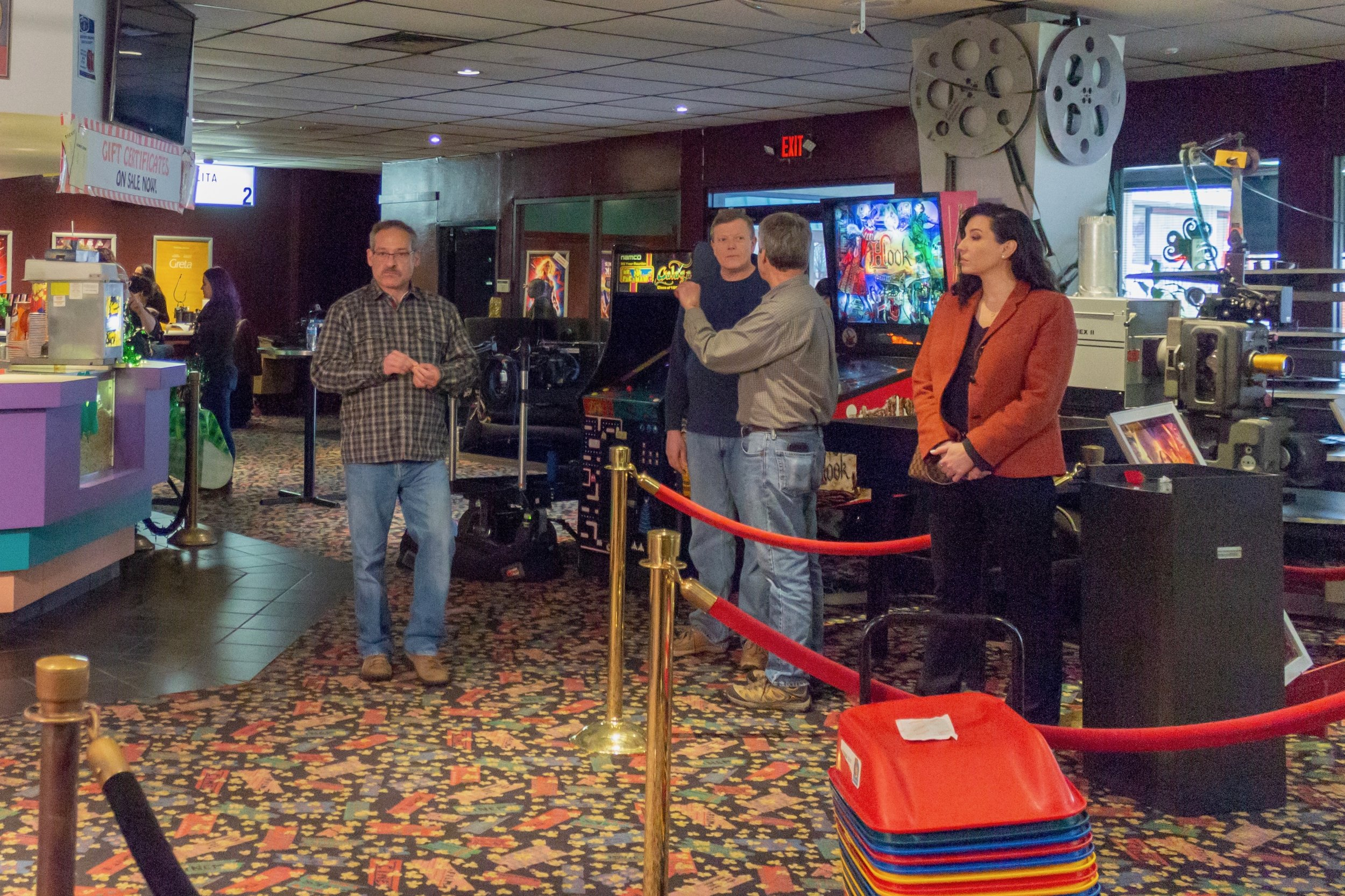 Left to right: Steven P. Neilson, executive producer of  Oh Crappy Day , checks out the lobby of Mission Valley Cinema, while Duane Therriault, our 2nd assistant director, gets extras ready for the next shot. Photo by Jonathan Okafo. Copyright © 2019 Dagtype Films, LLC.