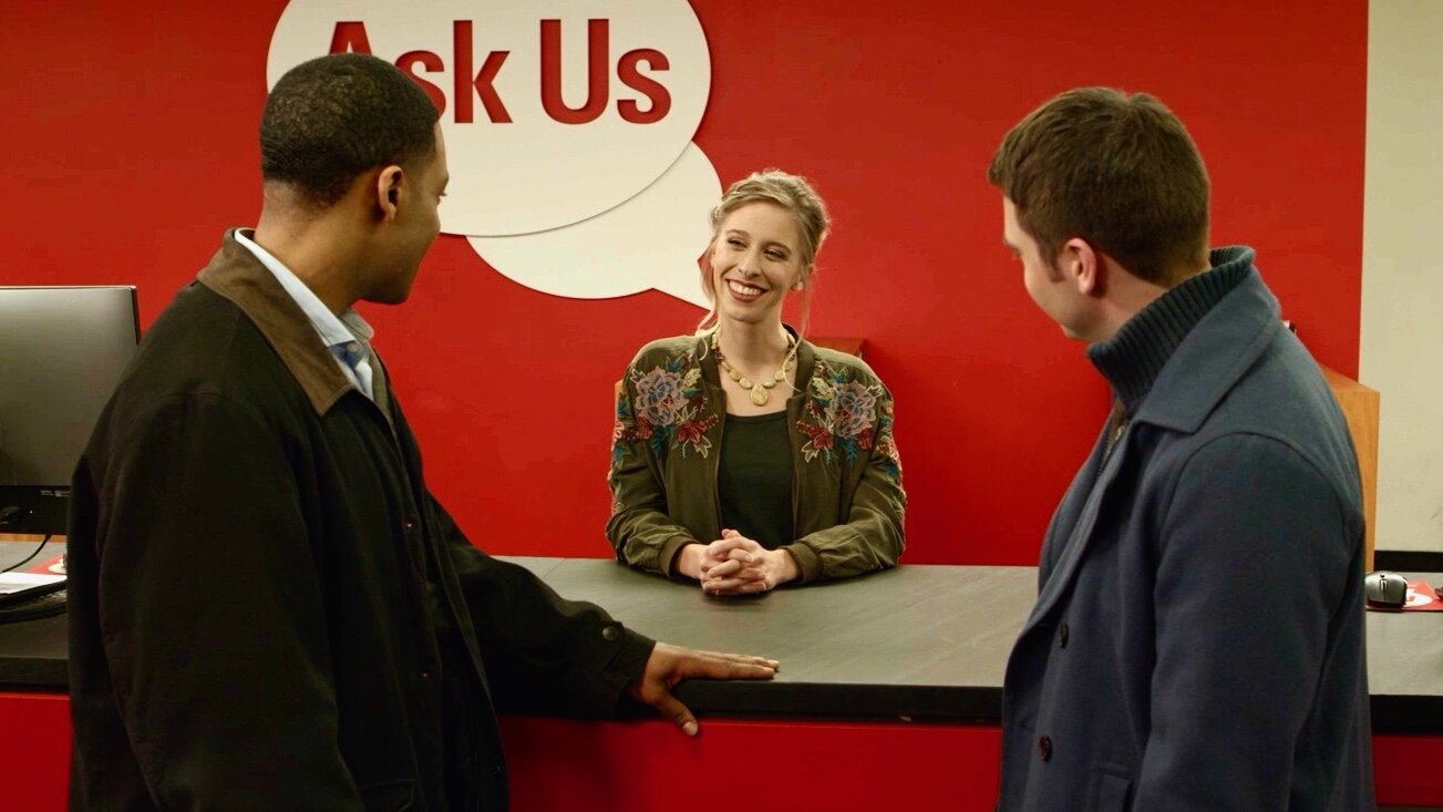 In a scene from  Oh Crappy Day , Jaime Wallace (Meghan) wears an embroidered jacket provided by Galatea Boutique of Raleigh. With her, from left to right, are Loosha Jones (Marcus) and Jordan Estes (Jared).