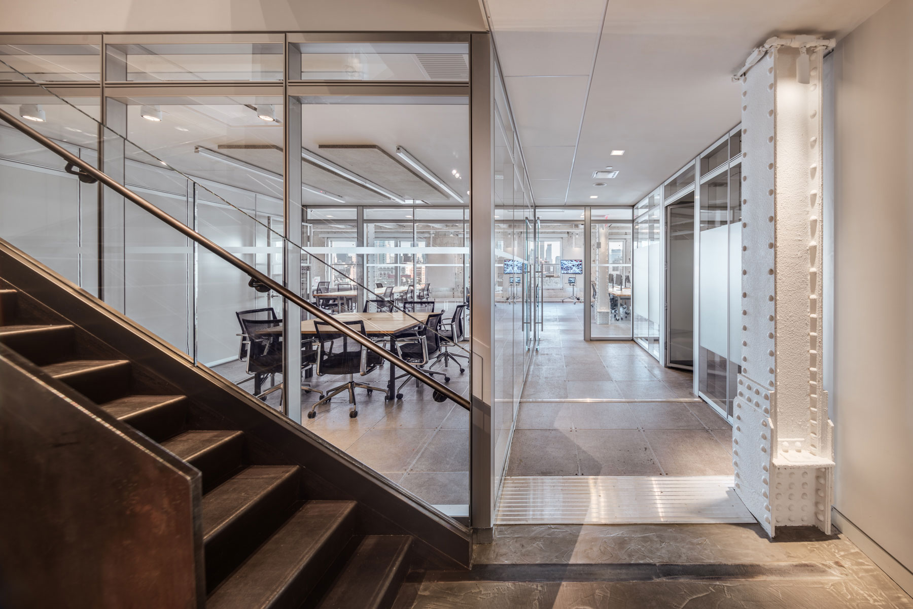 First Look Media, Landmark Building, Manhattan, New York City, Interior Architecture, Adaptable Office, Raised Floor, Steel Stair, Steel Columns, Rivets, Glass, Meeting Room