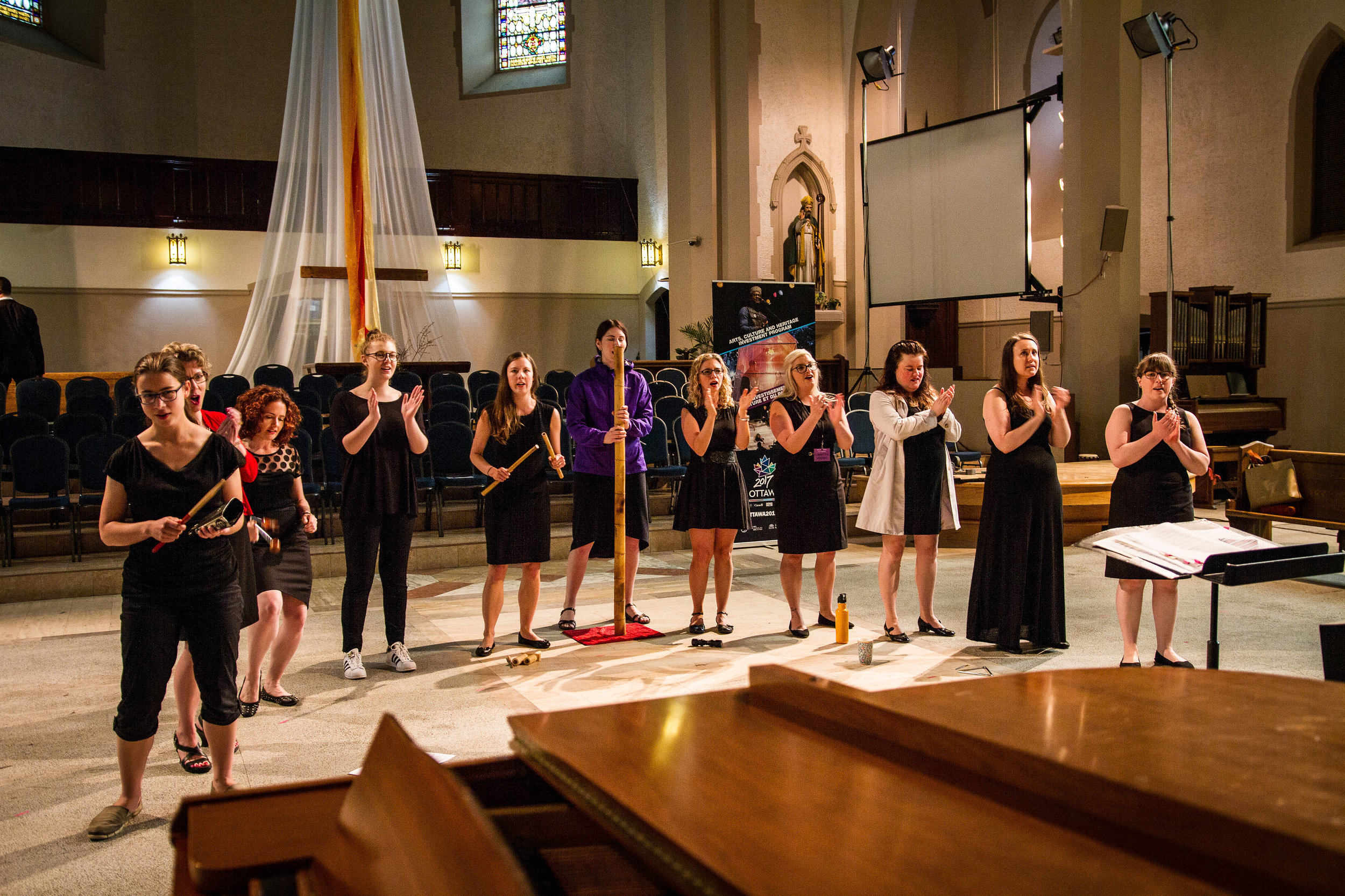 "Rehearsing Stephen Hatfield's ""Überlebensgross"" before the final  Sing Ottawa en choeur  festival concert.  Photo Credit:  Anthony Boxell Photography"