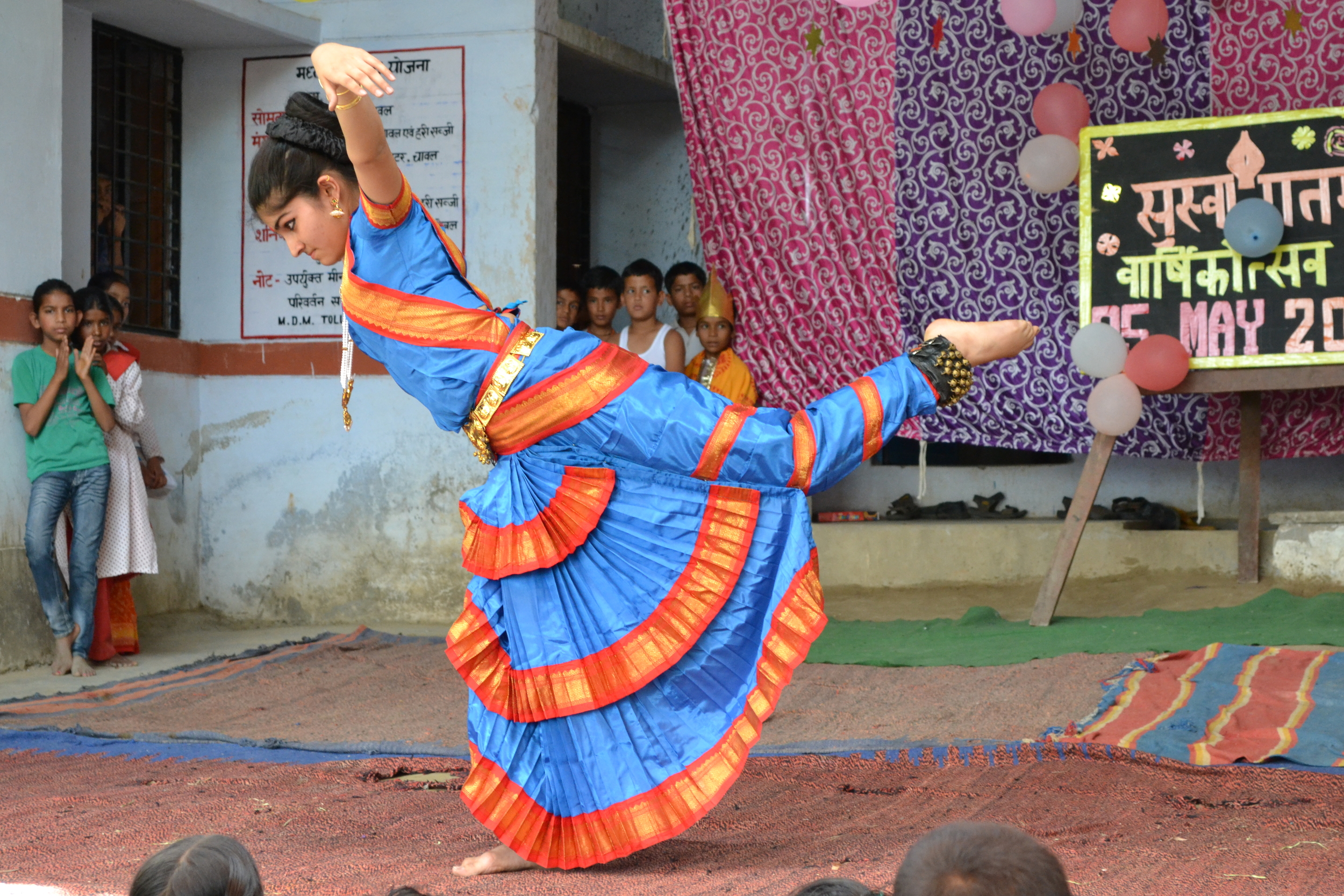 Rachna's daughter, Tara, performs a classical dance for the local village school.