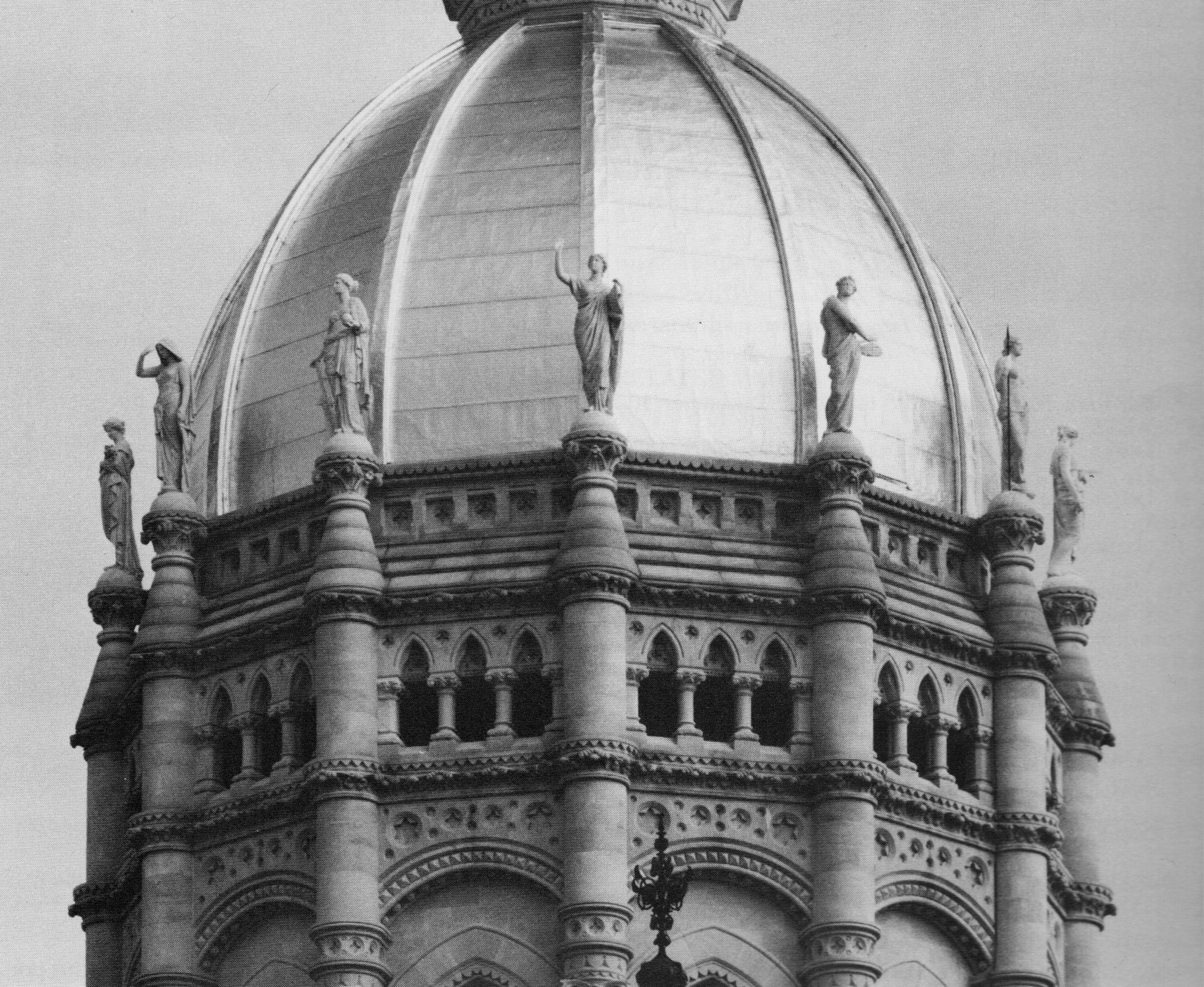 The dome of the State Capitol Building with 12 marble statues    .