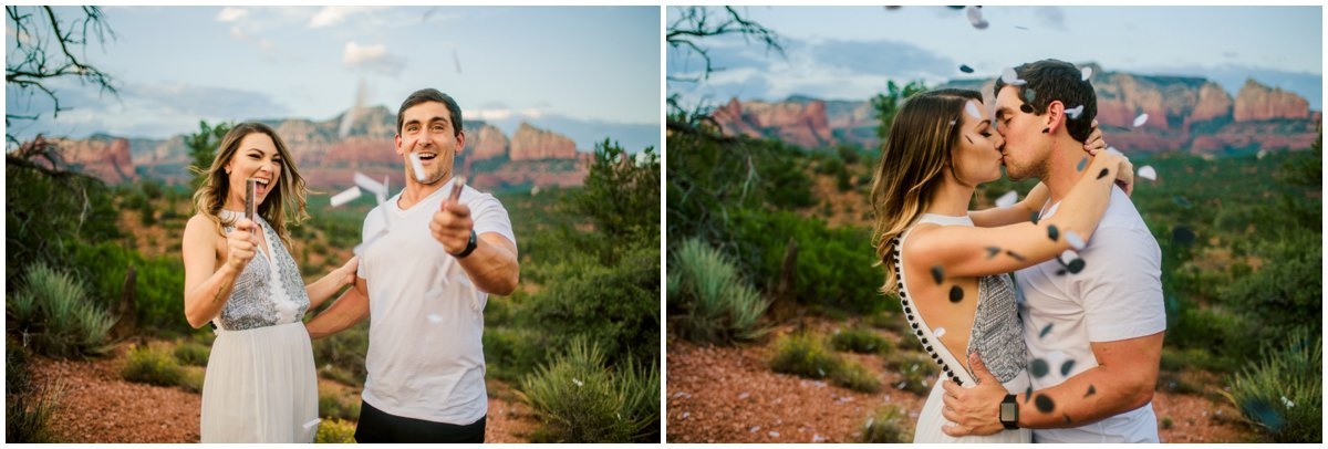 Summer Sedona Engagement Photos throwing confetti with Sedona Red Rock Mountains in the background.