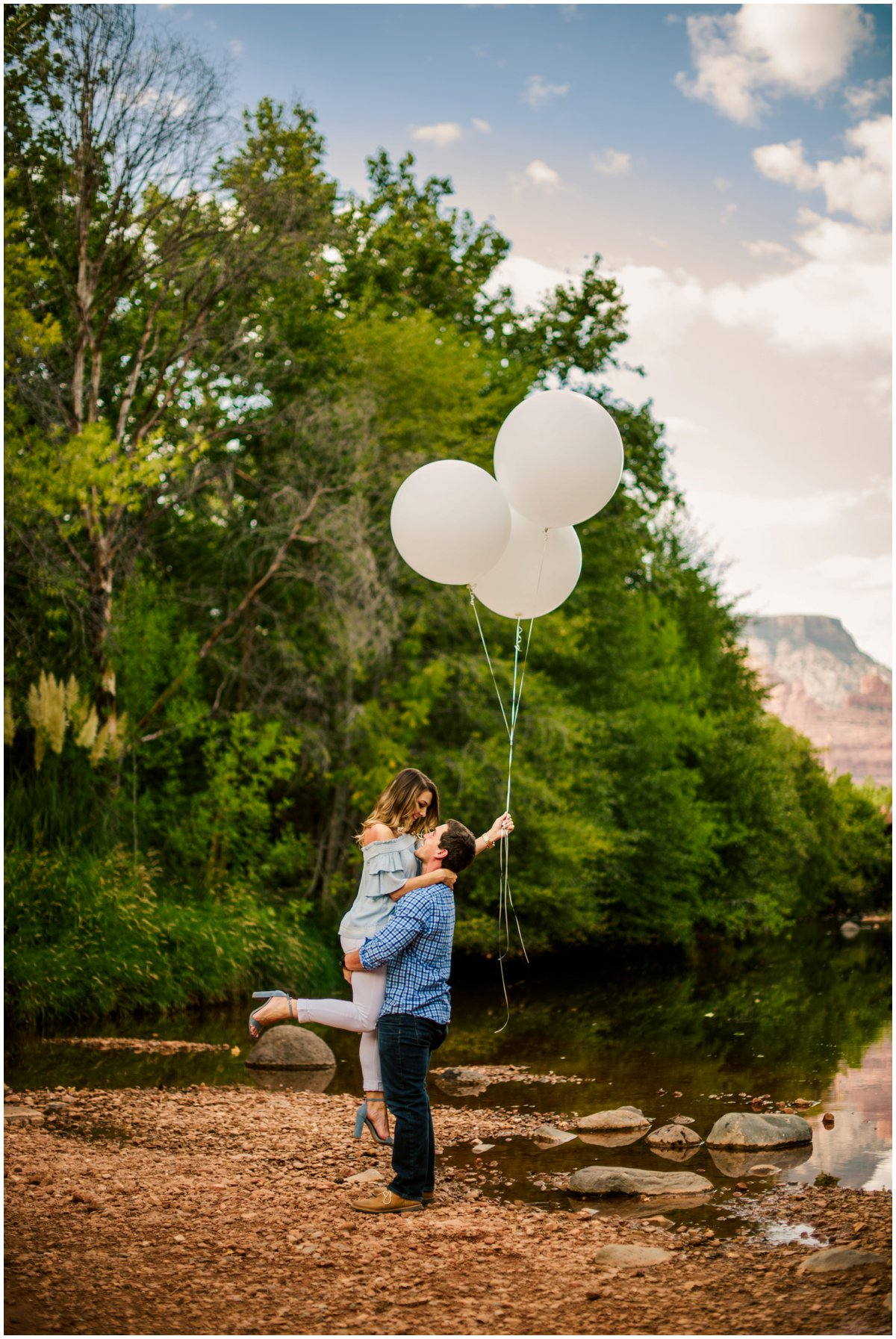 Summer Sedona Engagement Photos with balloons and the Sedona Red Rock Mountains in the background.